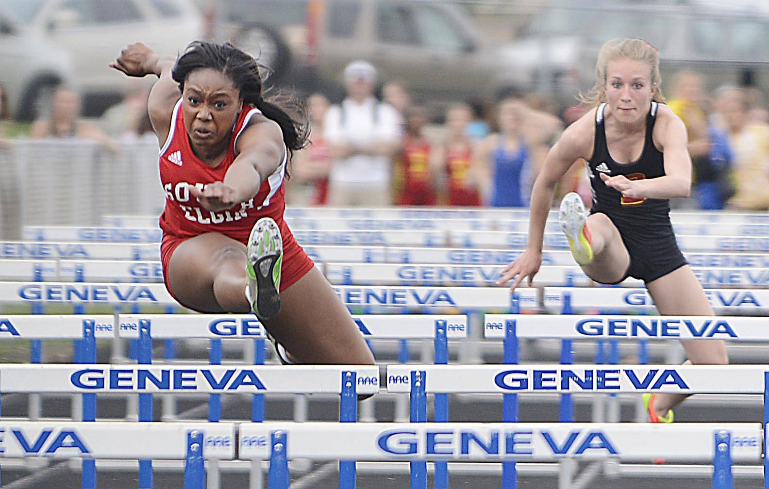 South Elgin's Taylor Withers leads Batavia's Taylor Stieve in the 100 meter hurdles Thursday at the Upstate Eight Conference girls track meet at Geneva High School.