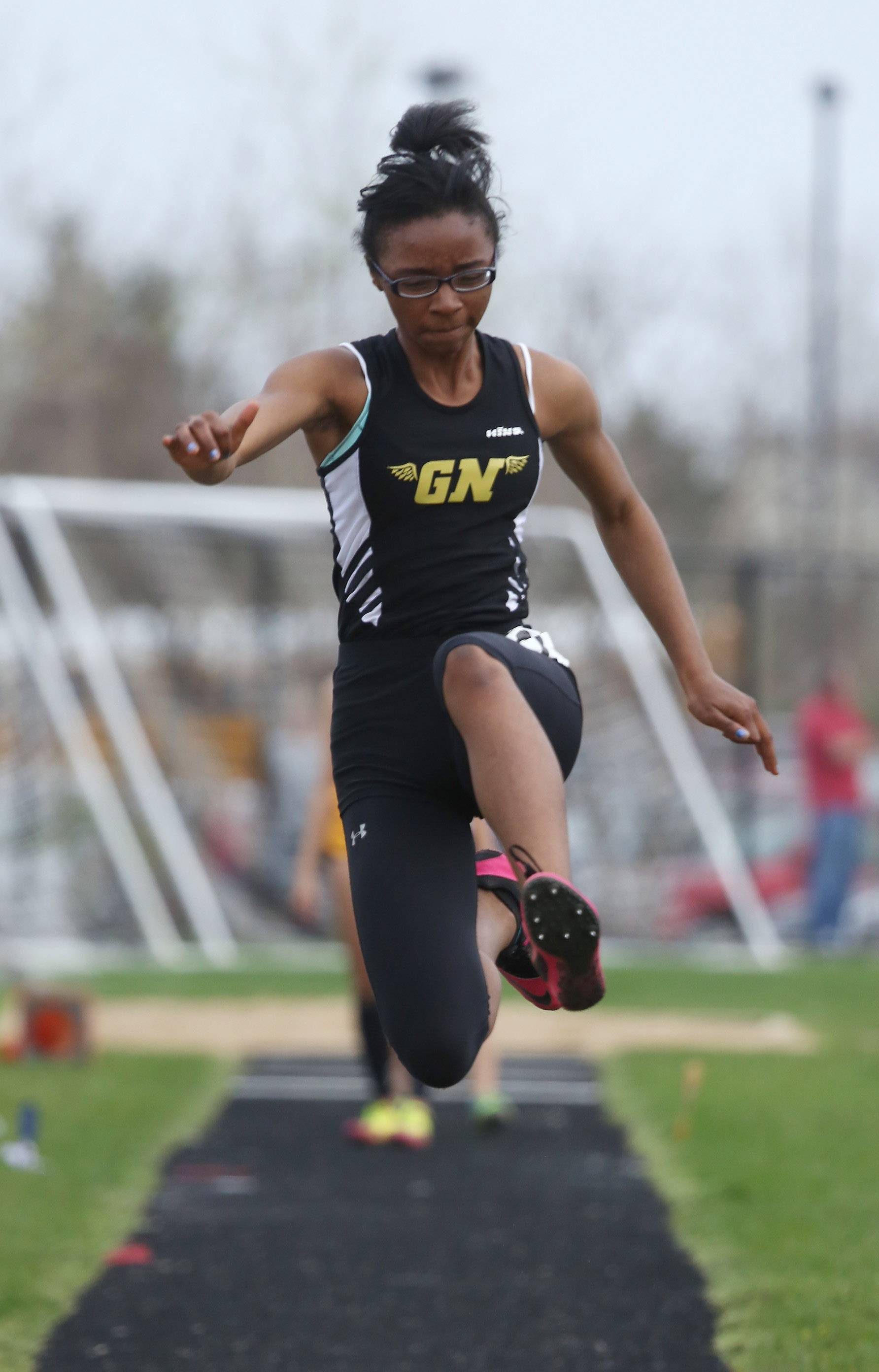 Grayslake North Milan Stubblefield competes in the long jump during the Fox Valley Conference meet Thursday at Grayslake North.