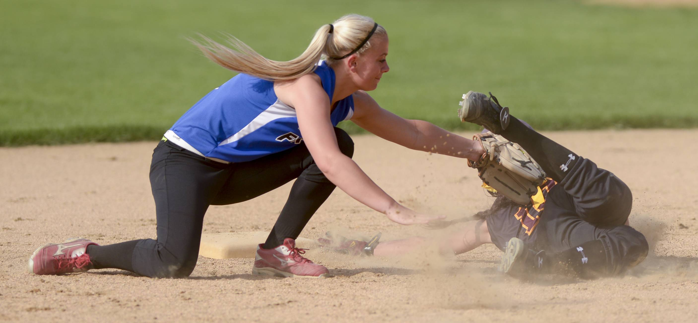 St. Francis' Emma Chapman picks off Montini's Cristina Barrett during a third inning rundown in Wheaton Thursday.