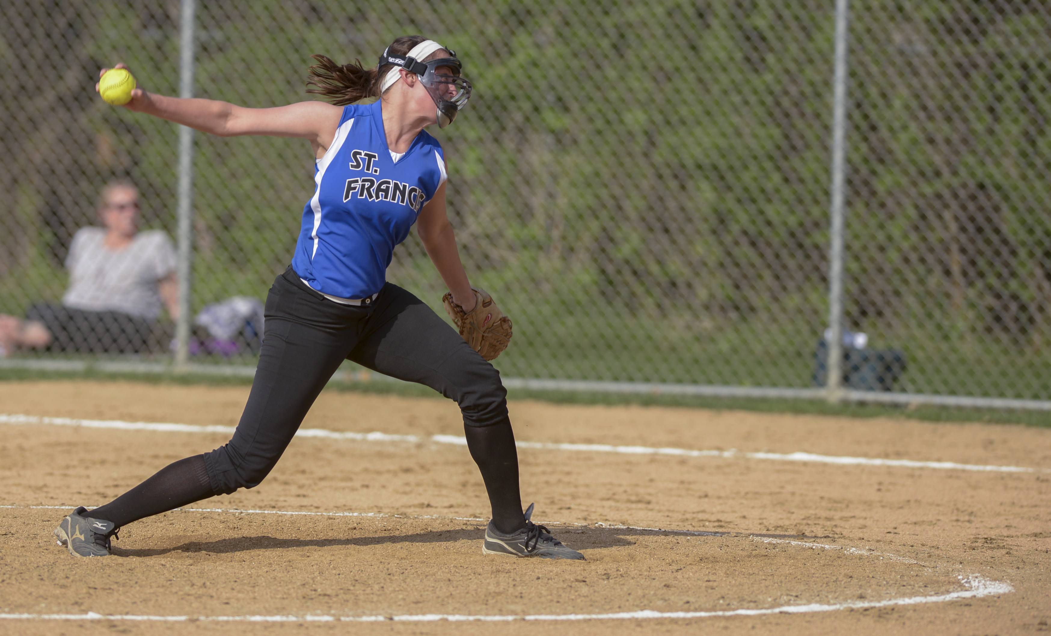 St. Francis' Maggie Remus pitches against Montini during softball action in Wheaton Thursday.