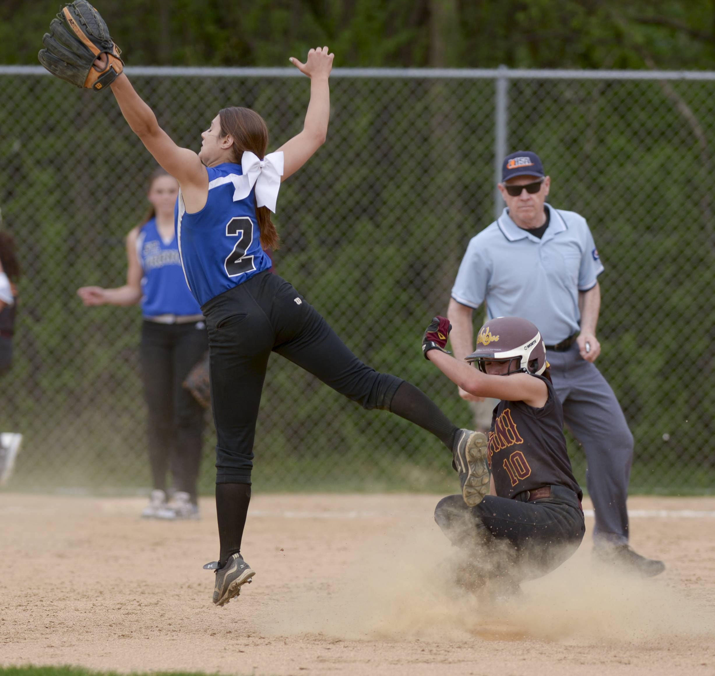 St. Francis' Jamie Smith comes up short as Montini's Cristina Barrett makes it safely to 2nd during softball action in Wheaton Thursday.