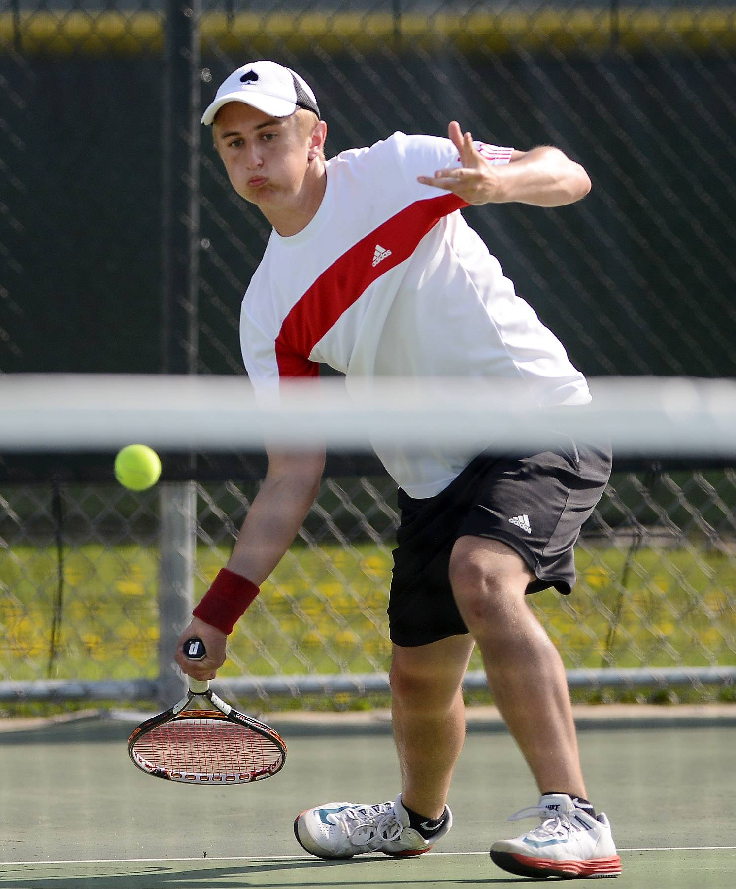 Tim Murat of Batavia reaches for a half volley in his #1 singles match against Matt Ernst of St. Charles North during tennis action at Batavia Thursday.