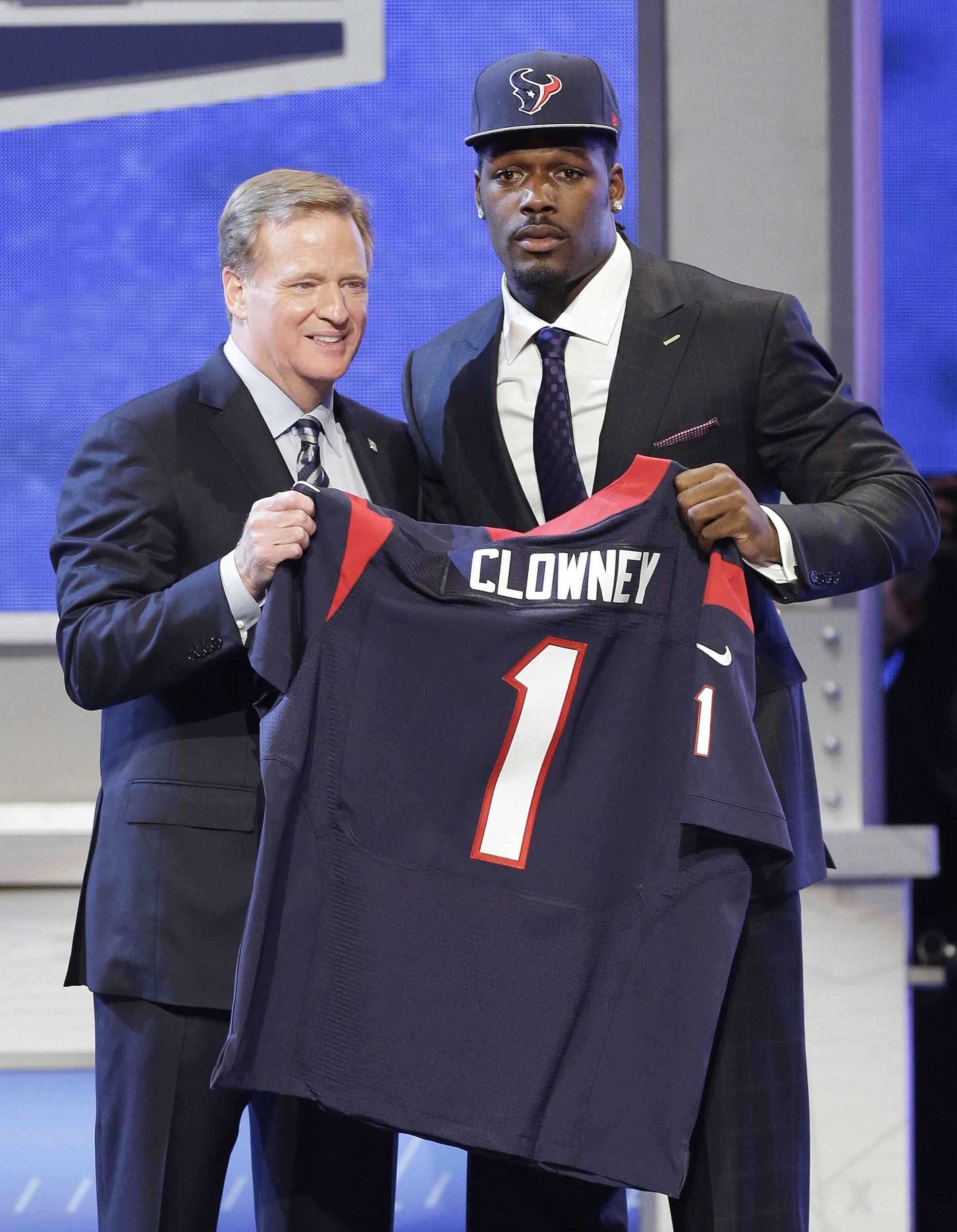 South Carolina defensive end Jadeveon Clowney hold up the jersey for the Houston Texans first pick of the first round of the 2014 NFL Draft with NFL commissioner Roger Goddell, Thursday, May 8, 2014, in New York.