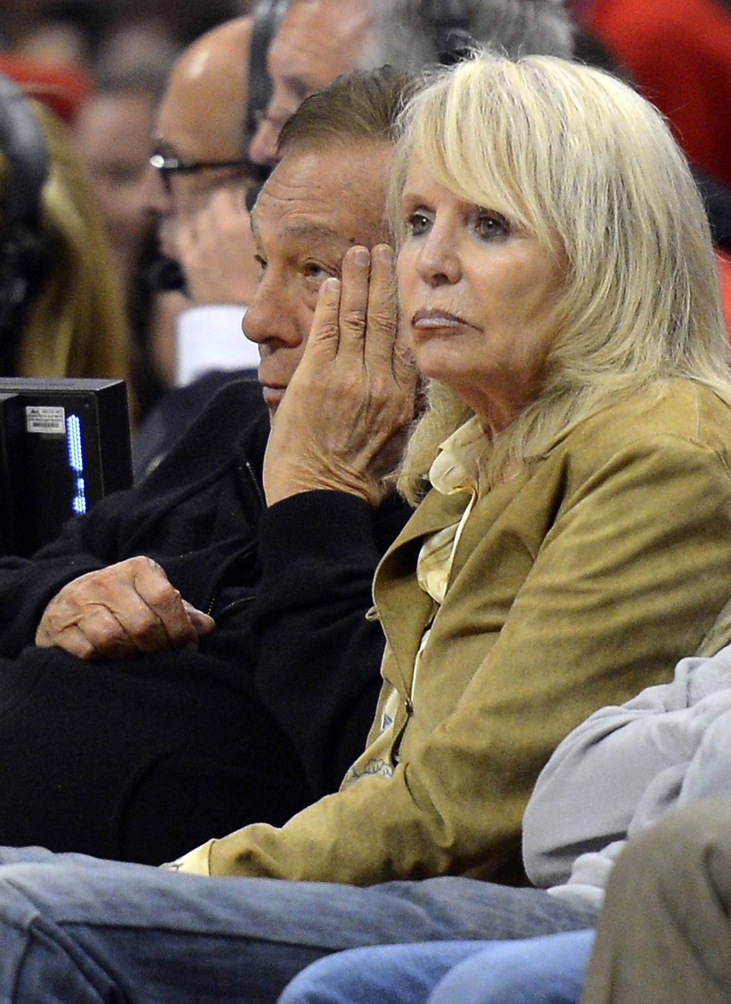 FILE - In this May 19, 2012, file photo, Los Angeles Clippers owner Donald Sterling, left, and his wife Rochelle watch during the second half in Game 3 of an NBA basketball playoffs Western Conference semifinal against the San Antonio Spurs in Los Angeles. An attorney representing the estranged wife of Clippers owner Donald Sterling said Thursday, May 8, 2014, that she will fight to retain her 50 percent ownership stake in the team.