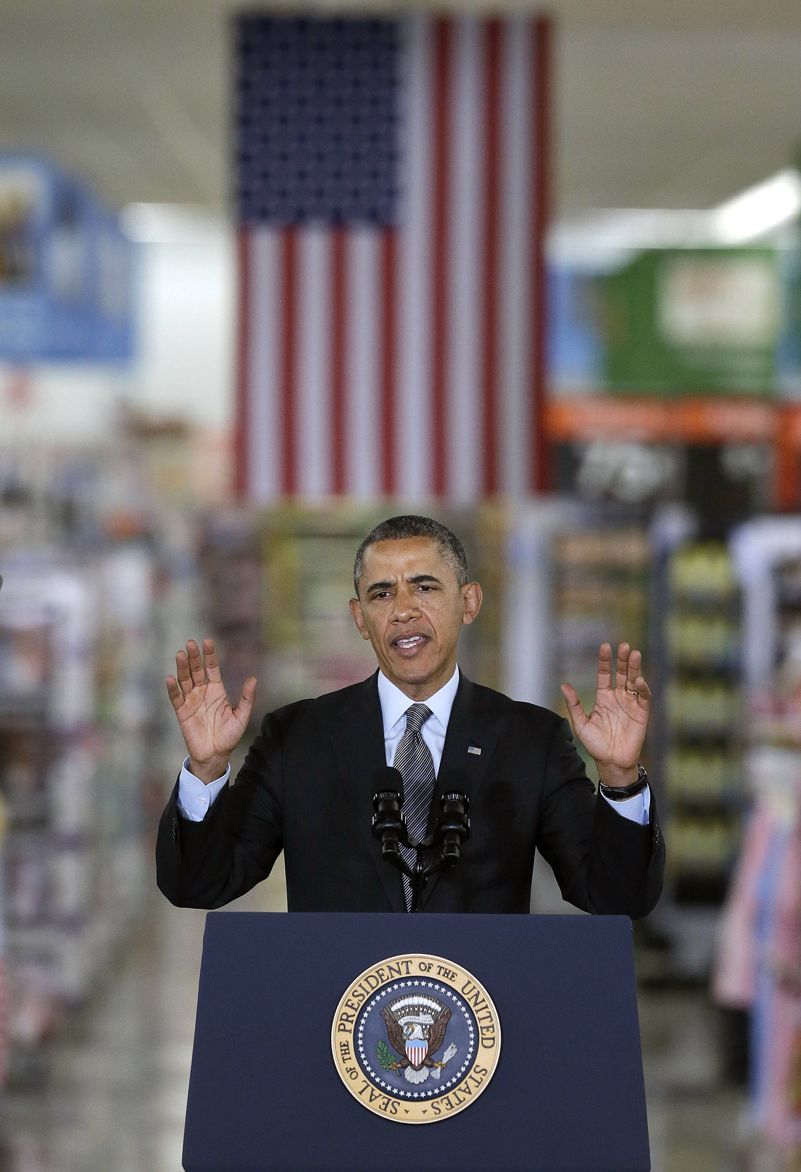 President Barack Obama speaks at a Walmart store Friday in Mountain View, Calif. Obama announced new steps by companies, local governments and his own administration to deploy solar technology.