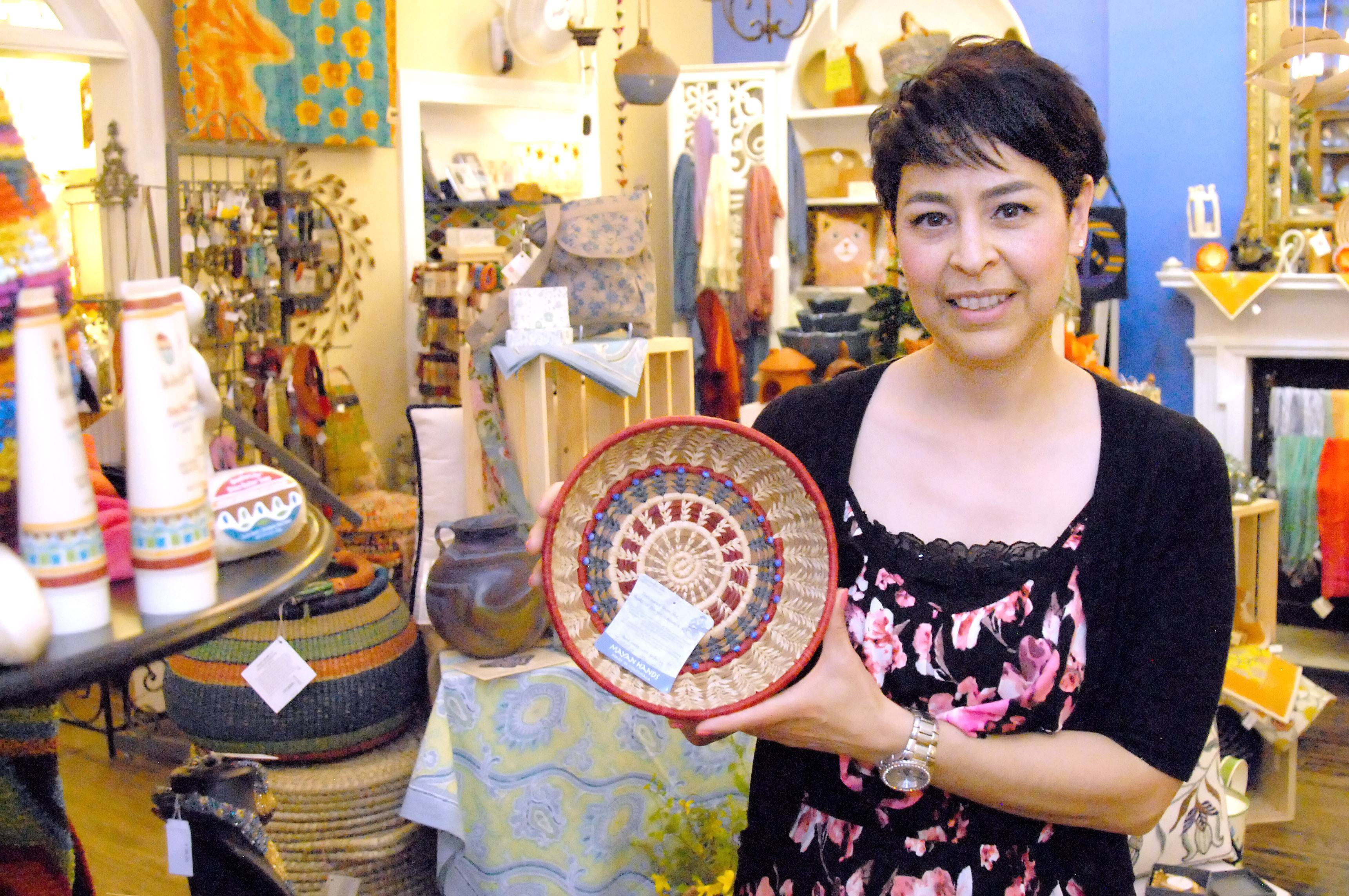 "The Little Traveler store in Geneva has added a Fair Trade Gallery to its many departments. ""The feeling is that this is retail with a soul,"" said gallery manager and buyer Annette Shamloo. ""It captures your heart."" She holds a hand-woven pine-needle basket with glass beads made by a Mayan artist."