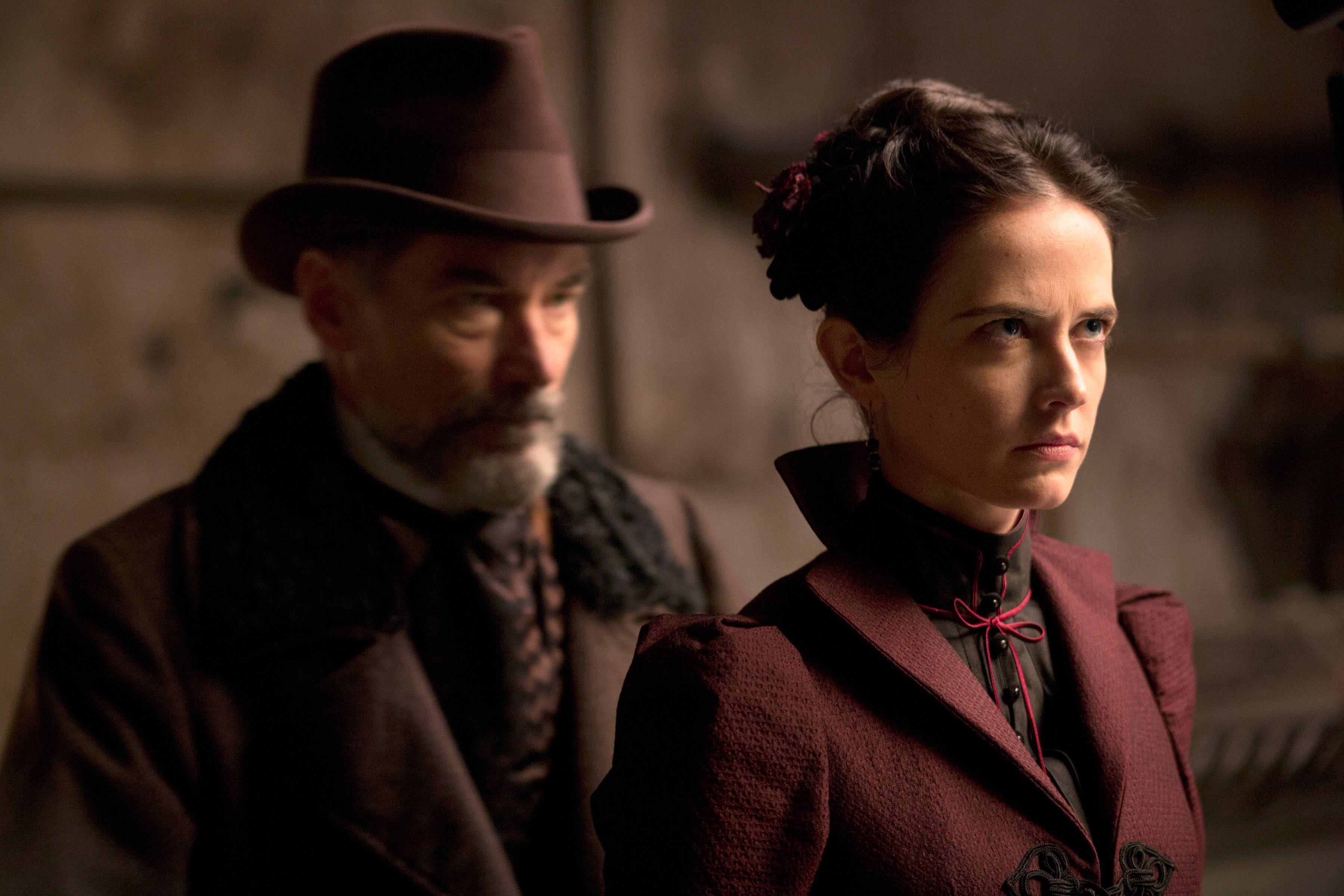 "As he searches for his daughter, Sir Malcolm (Timothy Dalton) seeks help from mysterious medium Vanessa Ives (Eva Green) in Showtime's ""Penny Dreadful."""