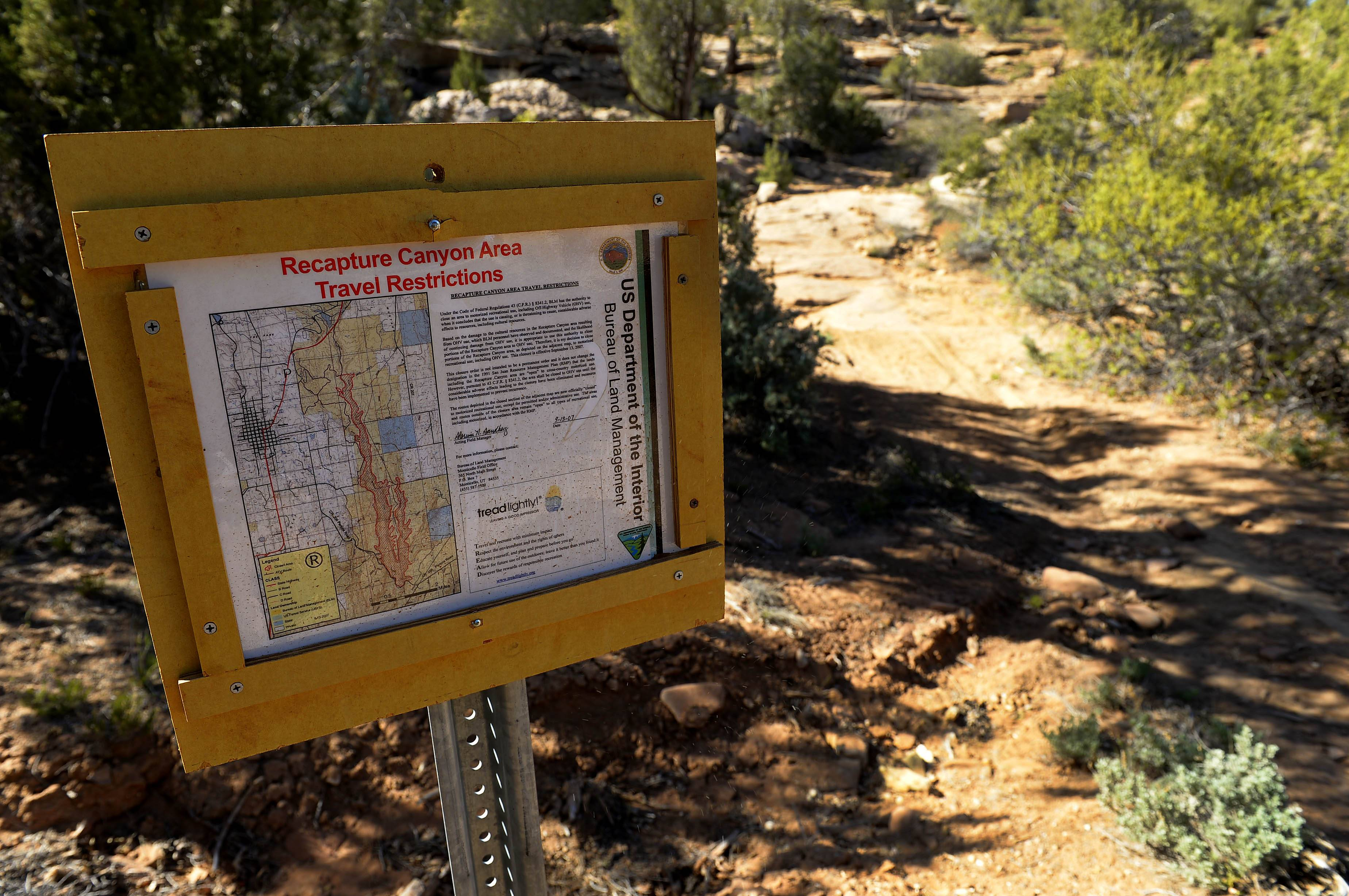 Signs detail travel restrictions and no motorized use throughout Recapture Canyon in Utah.