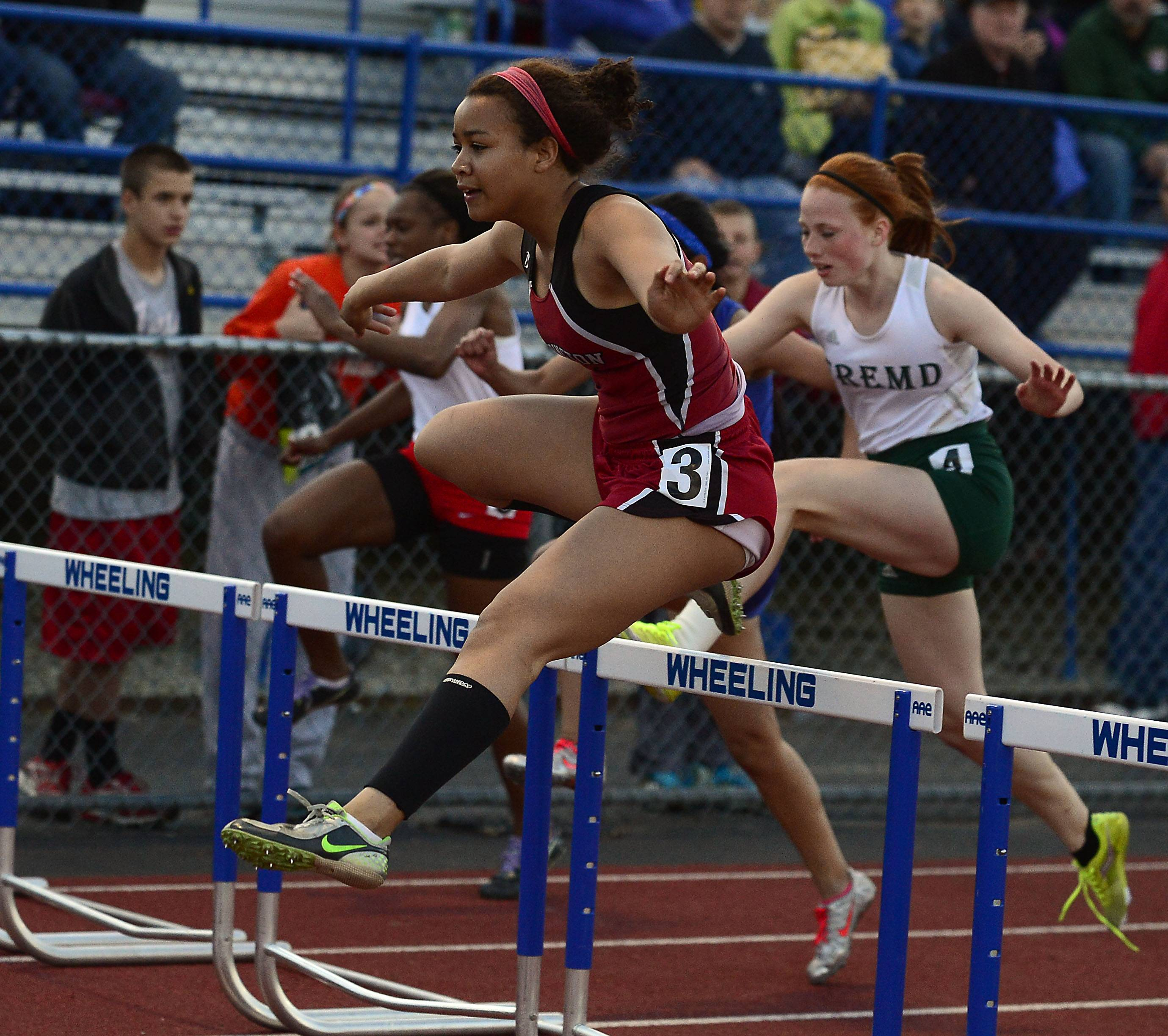 Joyce Taylor of Barrington competes in the 100-meter hurdles during the MSL meet at Wheeling on Friday.