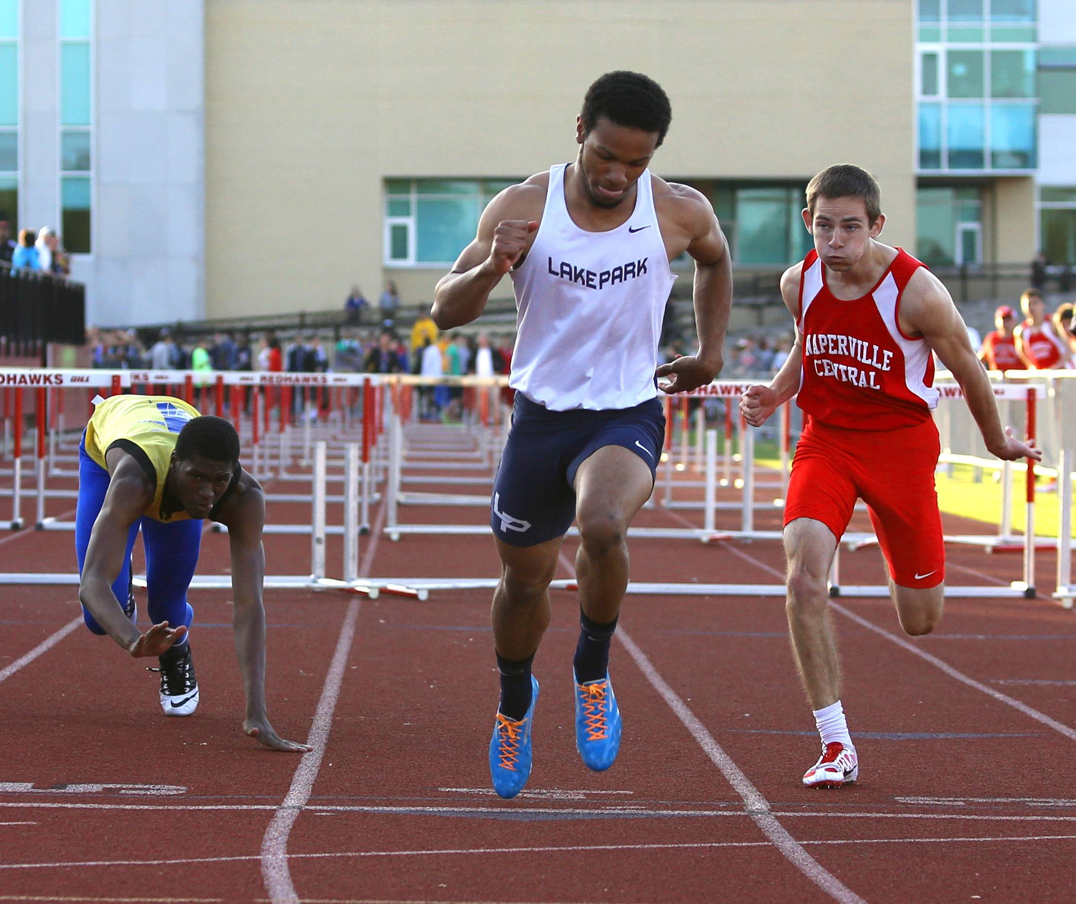 Lake Park's Antonio Shenault wins the 110-meter hurdles during the DuPage County boys track meet Friday. Wheaton North's Steven Connor, left, and Naperville Central's Michael Jopes, right, also raced.