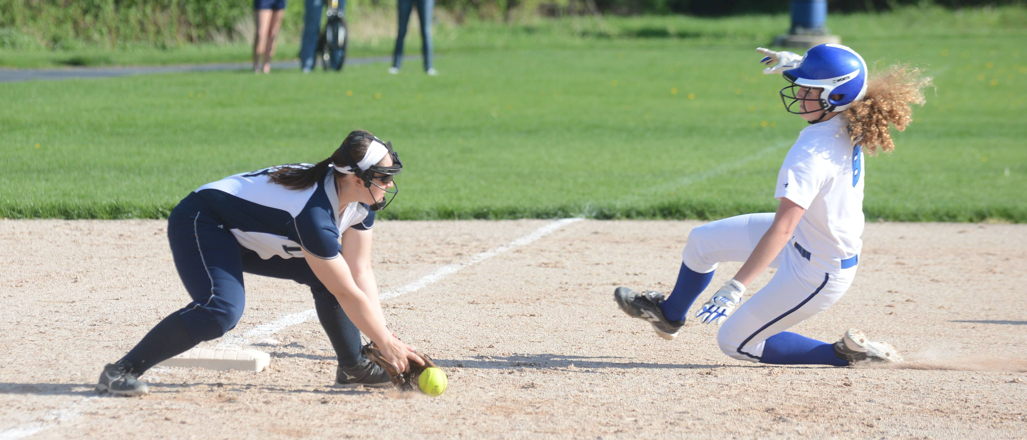 #18 Bella Daly of Lisle gets ready to put the tag on #9 of Peotone Jordan Nichols during the Peotone at Lisle softball game Friday.