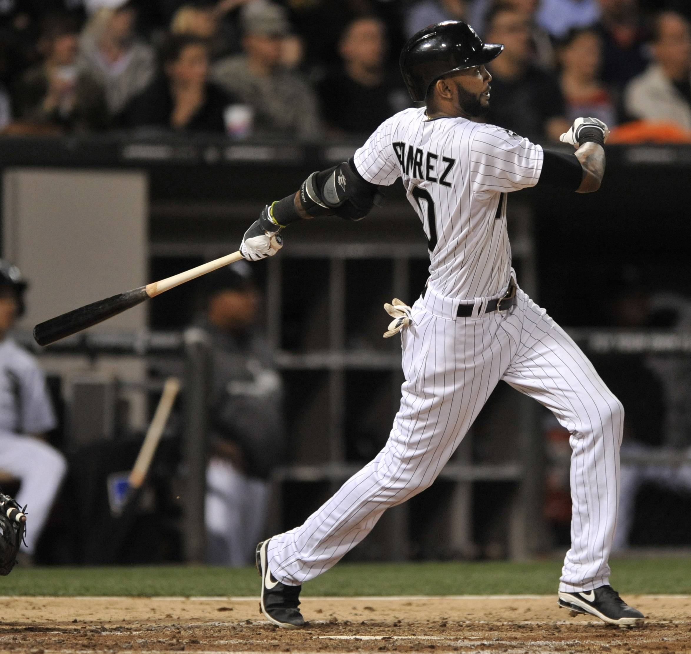 The White Sox's Alexei Ramirez watches his grand slam during Friday's game against the Arizona Diamondbacks at U.S. Cellular Field.