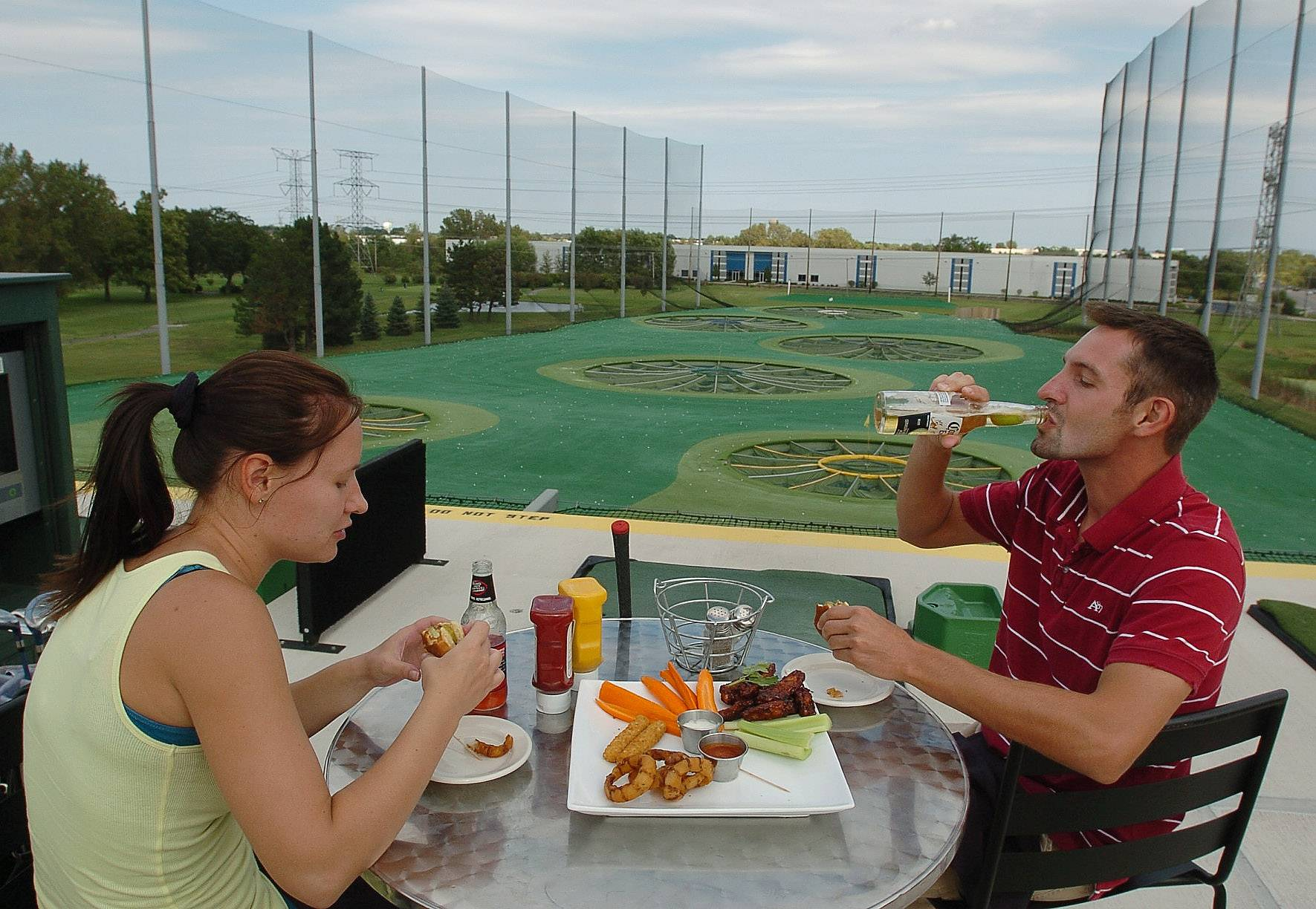 A full restaurant and bar are part of the setup for the golf entertainment facility Texas-based Top Golf plans to build in Naperville. Plans call for a $20 million, 65,000-square-foot driving range with 102 hitting bays and a corporate events area.