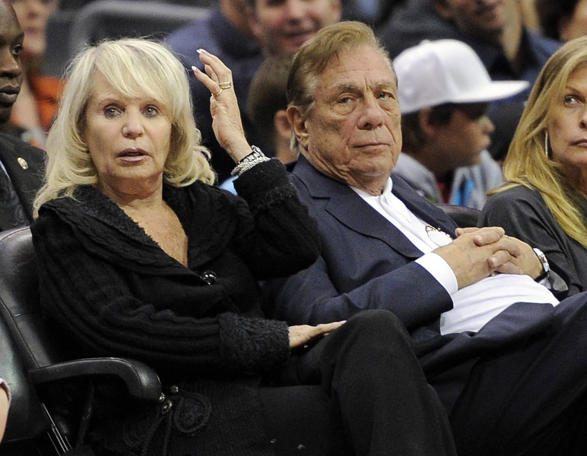 Los Angeles Clippers owner Donald T. Sterling, right, sits with his wife Rochelle during the Clippers NBA basketball game against the Detroit Pistons in Los Angeles.