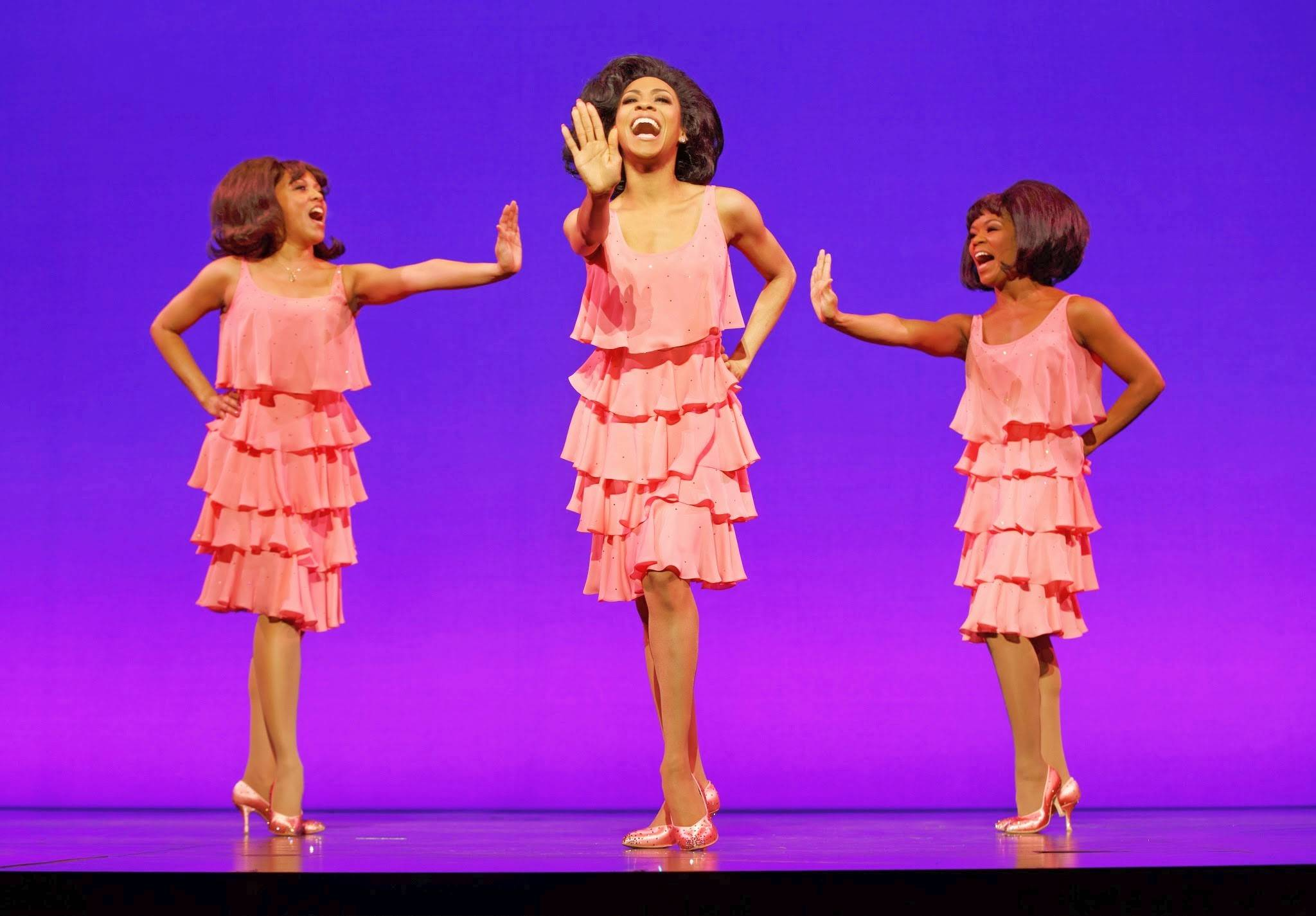 "Chicago native Allison Semmes, center, stars as Diana Ross in the national tour of ""Motown The Musical,"" which plays the Oriental Theatre in Chicago through Saturday, Aug. 9. Semmes is flanked by Krisha Marcano, left, as Florence Ballard and Trisha Jeffrey as Mary Wilson as they sing ""Stop! In the Name of Love."""