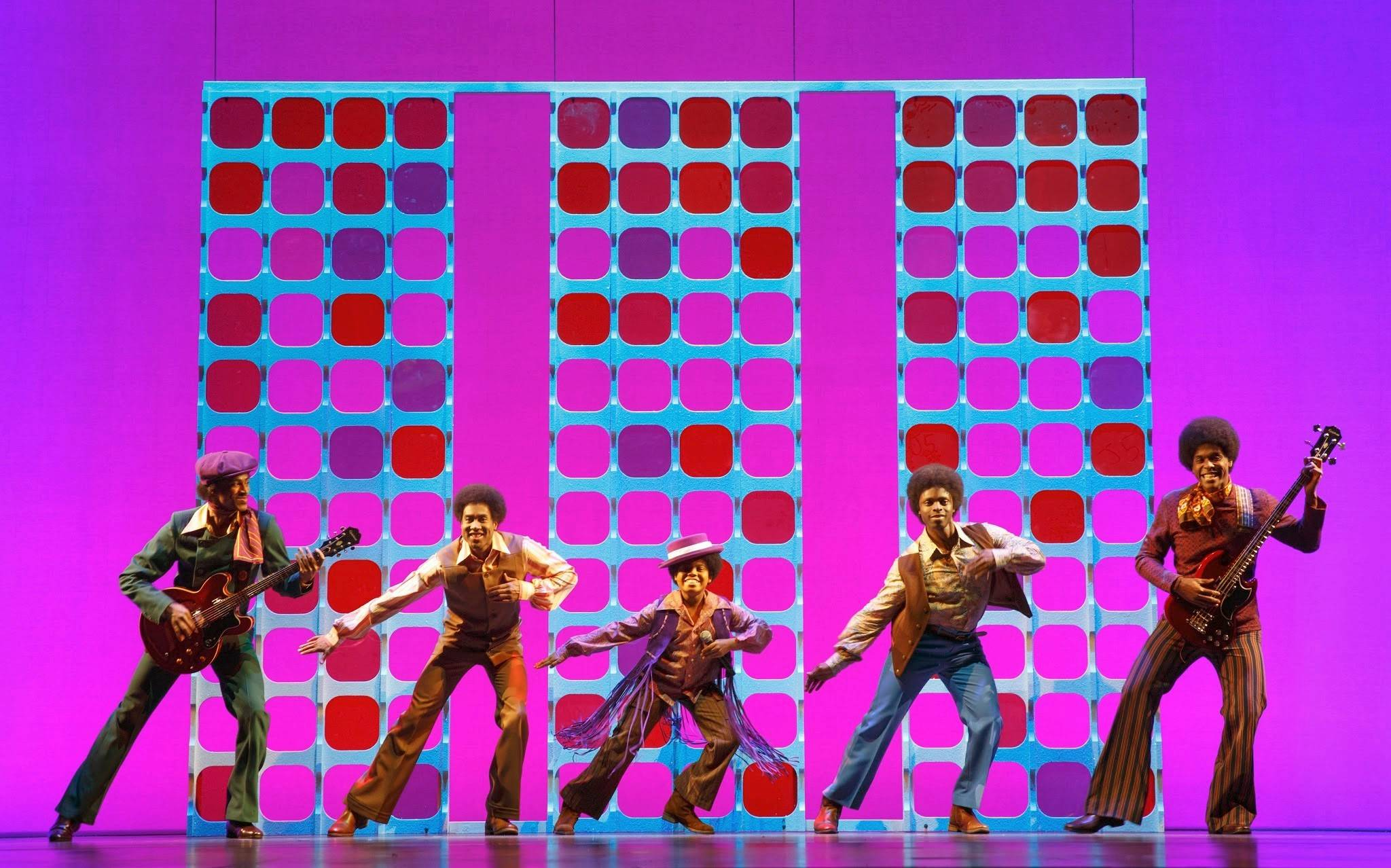 "Reed L. Shannon, center, stars as the young Michael Jackson with the Jackson 5 performing on TV in the national tour of ""Motown The Musical,"" which plays the Oriental Theatre in Chicago through Saturday, Aug. 9."
