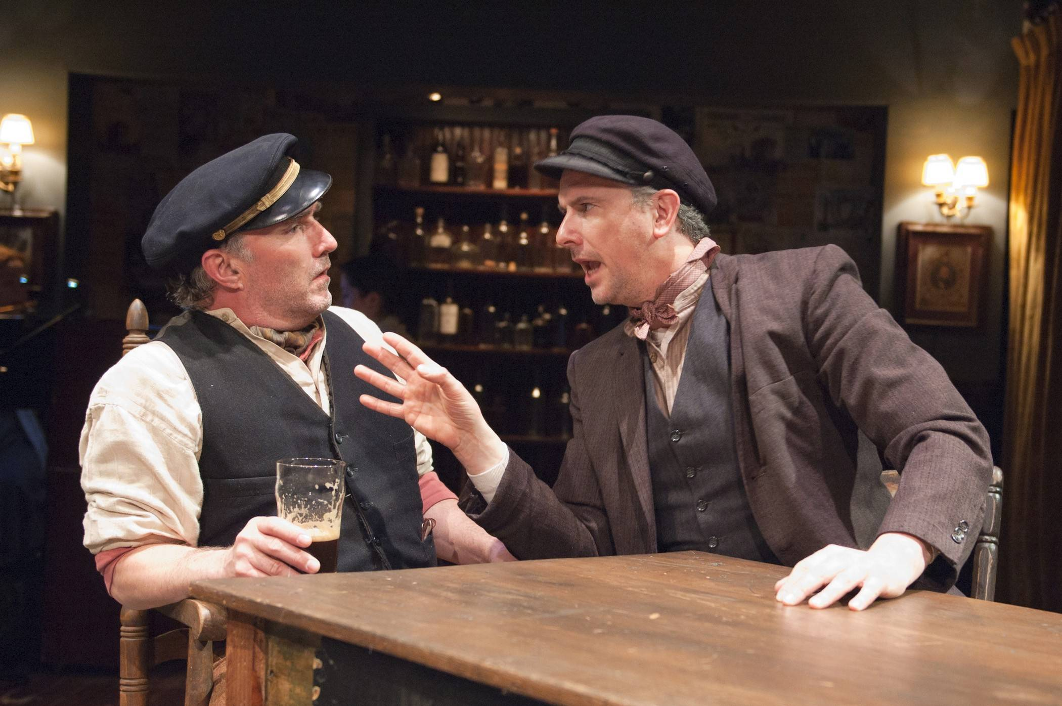 "Ron Rains, left, plays ""Captain"" Jack, the preening paycock (peacock) husband of the long suffering Juno, and James Houton plays his drinking buddy Joxer in TimeLine Theatre's ""Juno,"" the musical based on Irish writer Sean O'Casey's play ""Juno and the Paycock."""