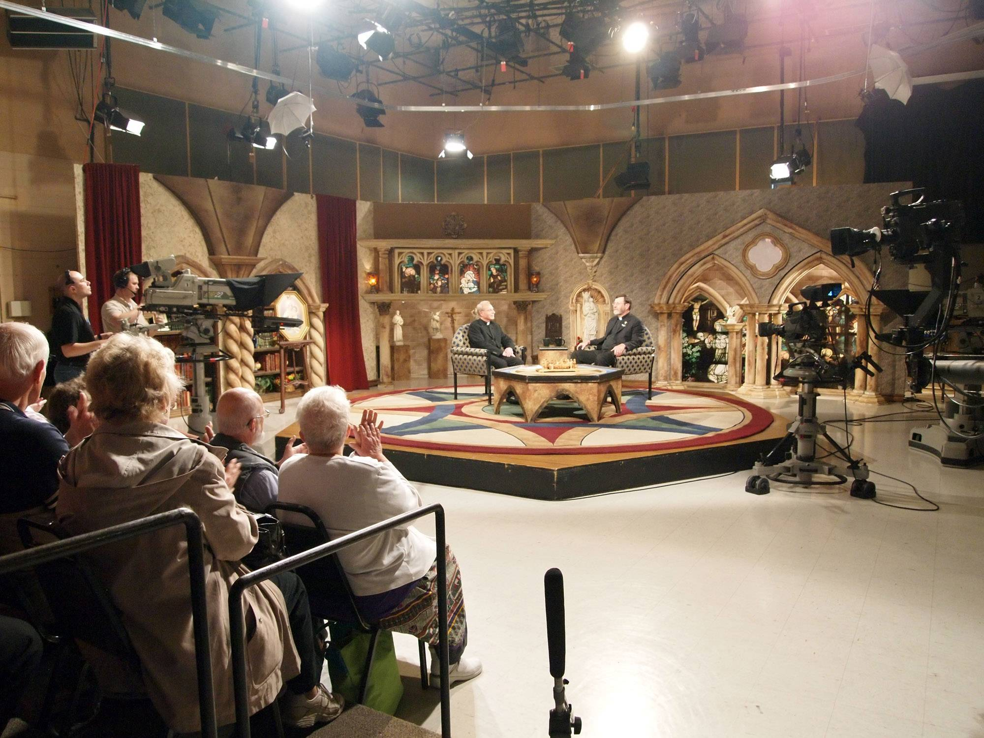 Visitors watch a taping of a show at Eternal Word Television Network in Birmingham, Ala. Located minutes from downtown in tree-covered Irondale, EWTN offers weekday tours of what it calls the world's largest religious media operation.