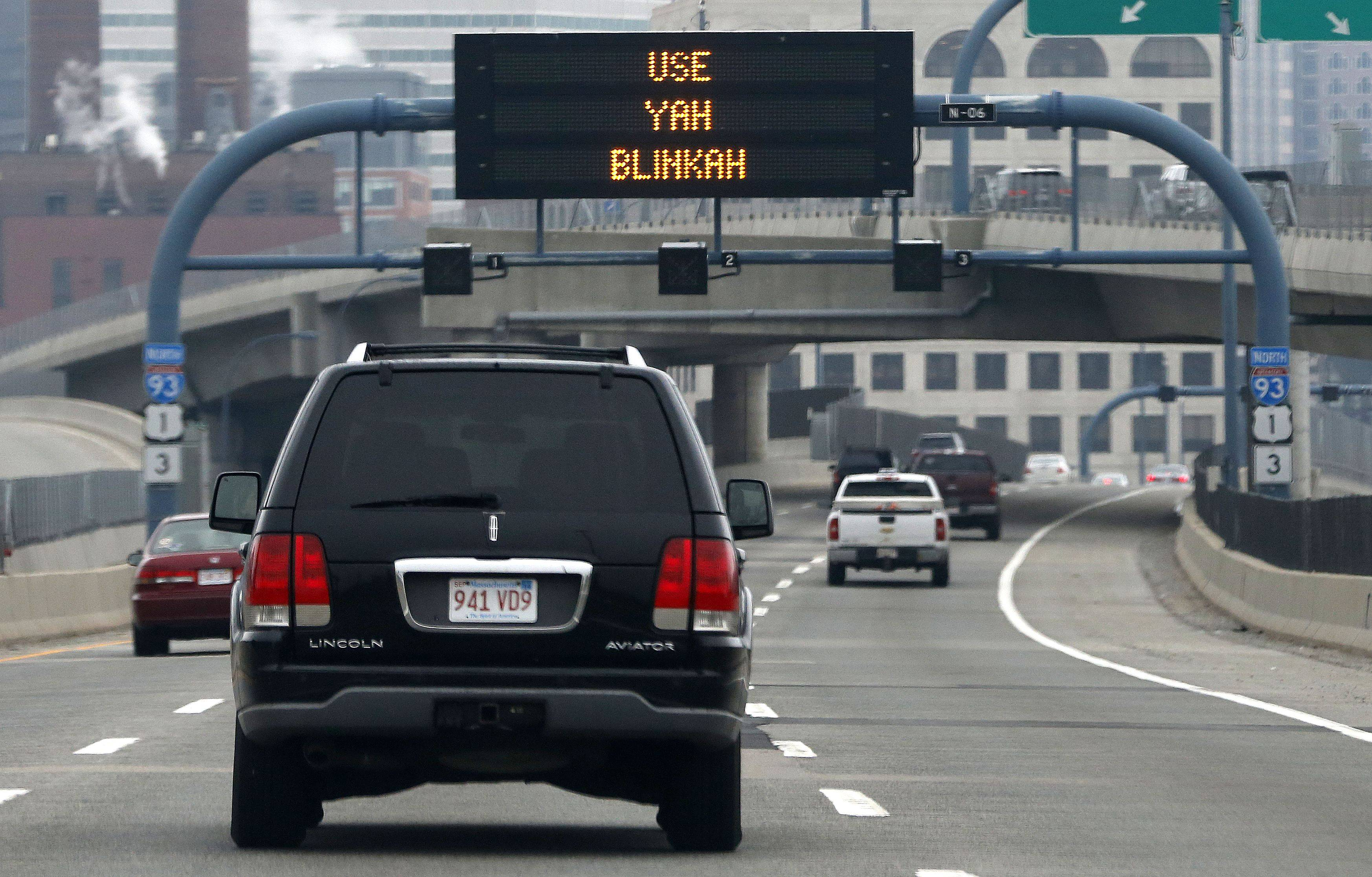 "An electronic highway sign on Interstate 93 in Boston sports the message ""Changing Lanes? Use Yah Blinkah."""