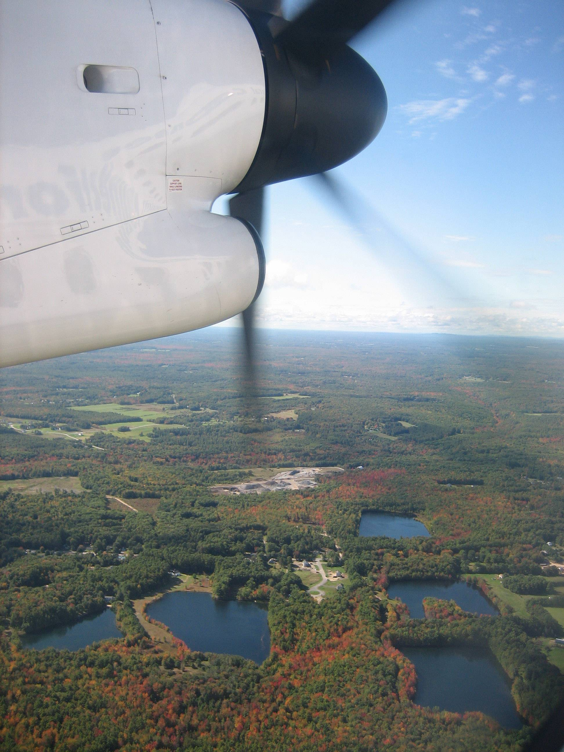 Beautiful fall colors can be seen from an airplane as it flies over Bar Harbor, Maine in September of 2009.
