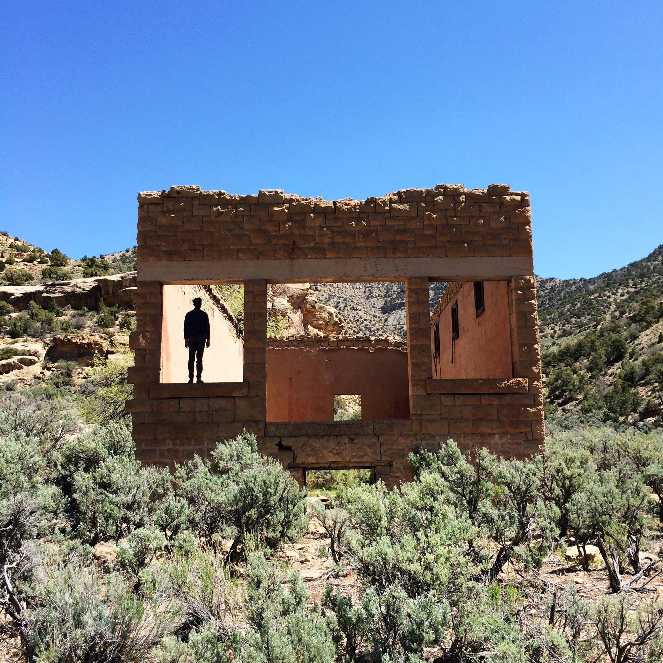 A figure stands in the window of an abandoned structure in Sego, Utah earlier this month, an abandoned mining town an hour north of Moab. Petroglyphs can be found on the canyons walls surrounding the old town.