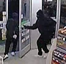 Two masked suspects, one armed with a pellet-type gun, robbed a 7-Eleven in Hanover Park early Thursday, police said.