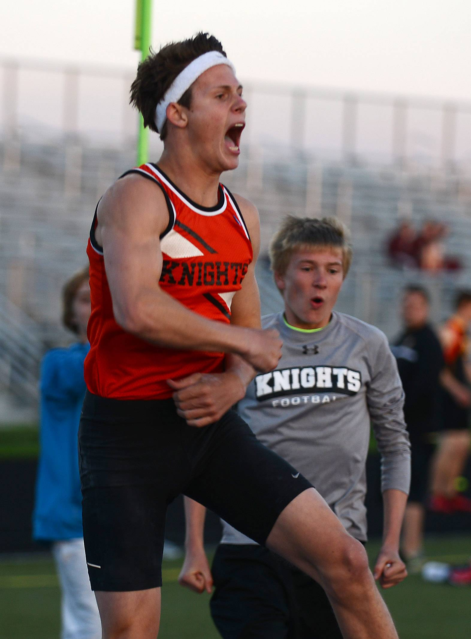 Kaneland's Dylan Kuipers celebrates after clearing 15- 3 1/2 at the Kane County boys track and field meet in Streamwood Friday.