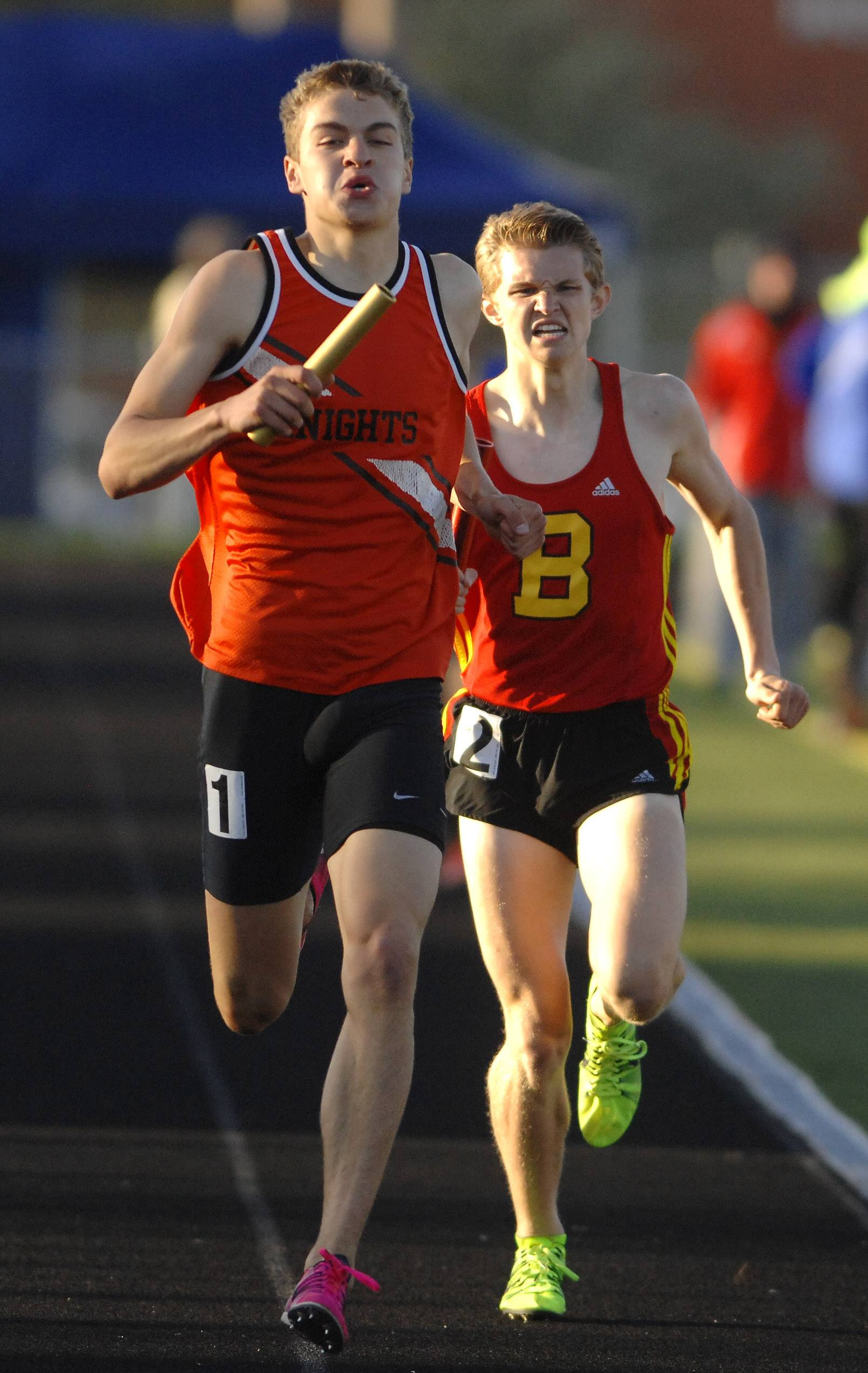 Nathaniel Kucera of Kaneland edges out Ryan Wieties of Batavia on the anchor leg of the 4x800-meter relay at the Kane County boys track meet in Streamwood Friday.