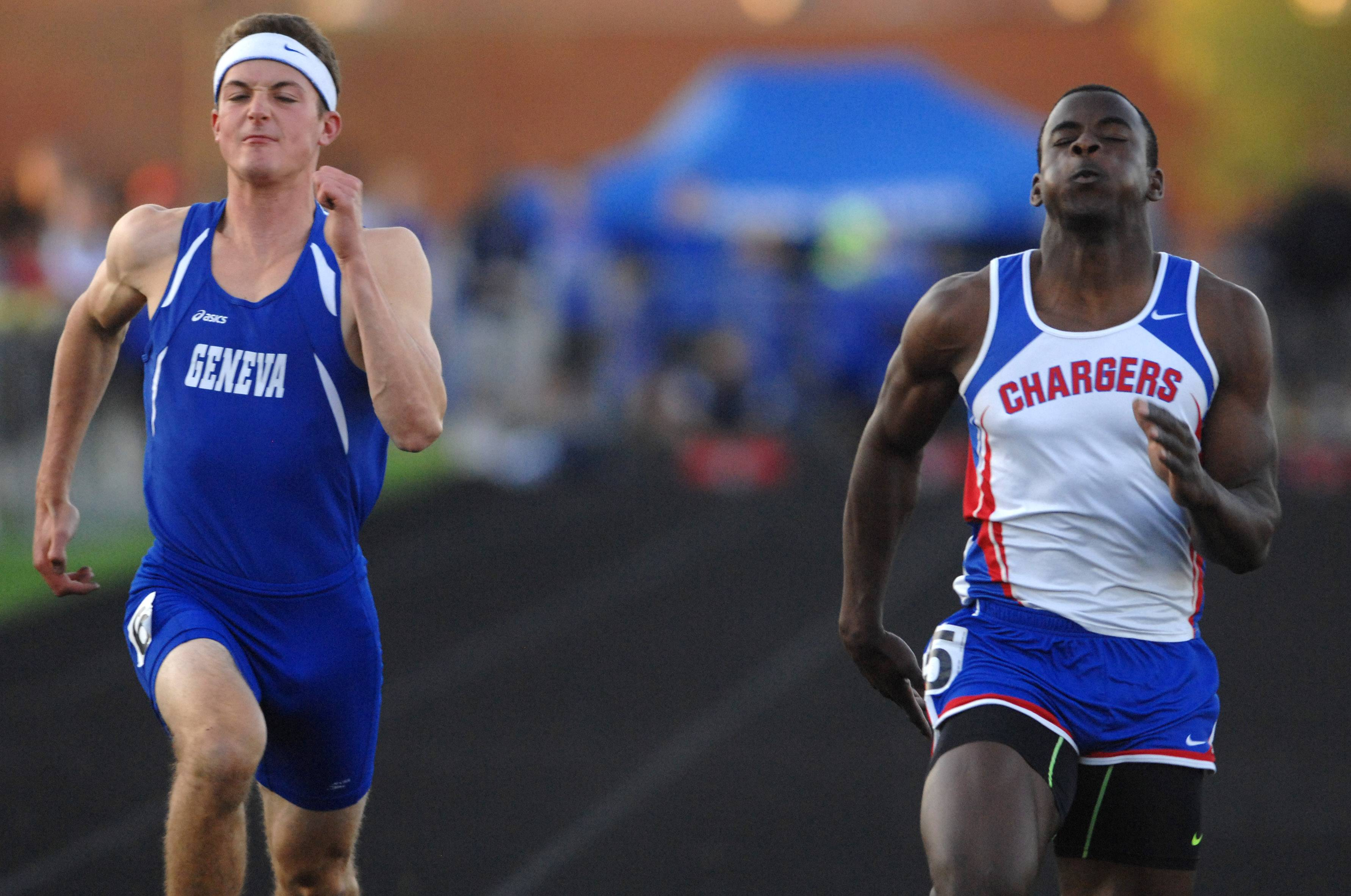 Milik Dunner of Dundee-Crown wins the 100-meter dash with Tim Roels of Geneva at left during the Kane County boys track meet in Streamwood Friday.