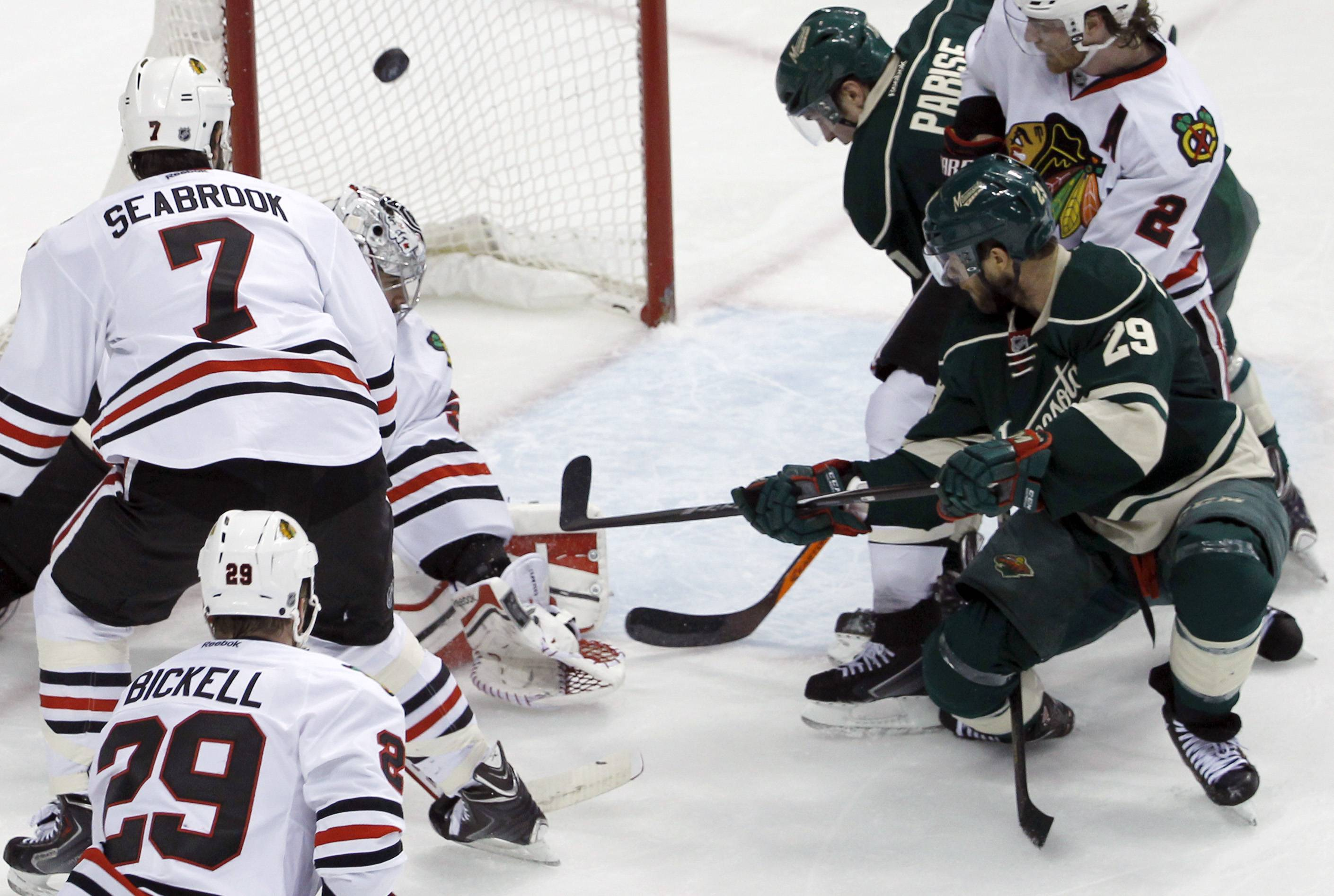 Minnesota Wild right wing Jason Pominville (29) scores on Chicago Blackhawks goalie Corey Crawford in front of Blackhawks defenseman Brent Seabrook (7) during the second period.