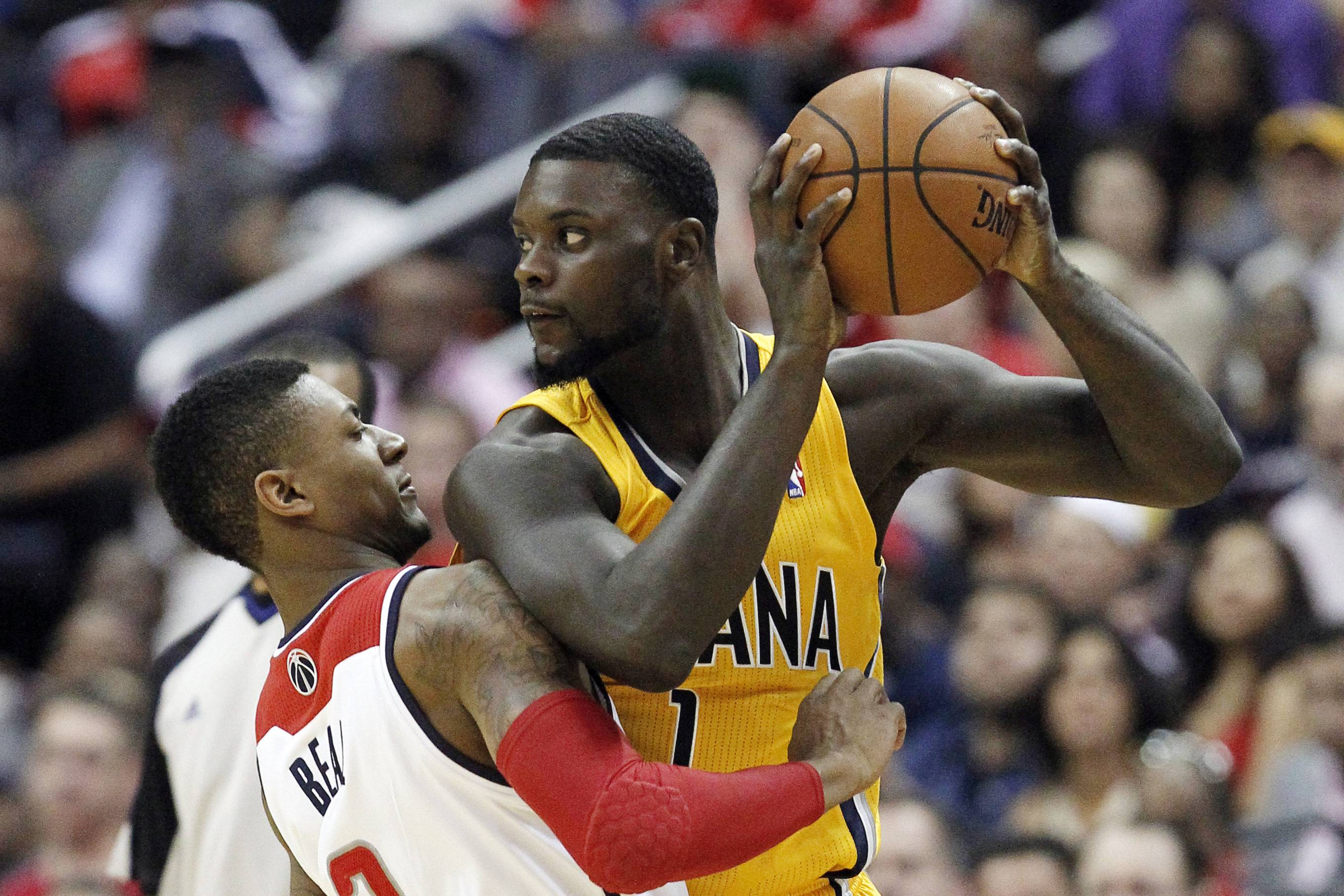 Indiana Pacers guard Lance Stephenson (1) looks for a way around Washington Wizards guard Bradley Beal during the first half of Game 3 of an Eastern Conference semifinal NBA basketball playoff game in Washington, Friday, May 9, 2014.