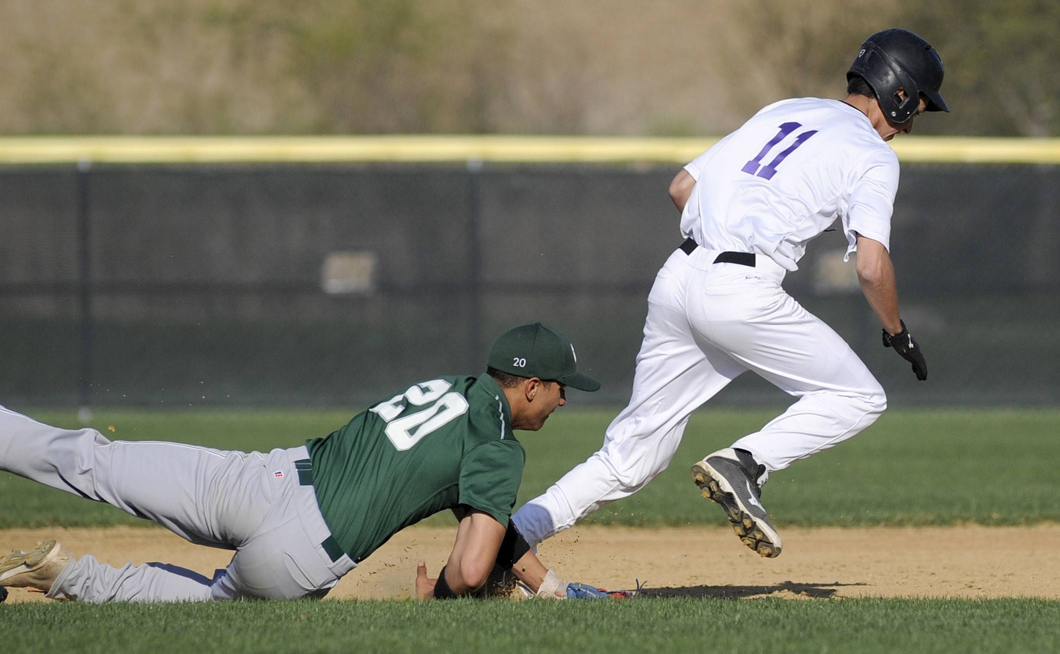 Grayslake Central's Freddie Landers tags out Hampshire's Alex Bahnick after chasing him between bases in the third inning at Hampshire Friday.