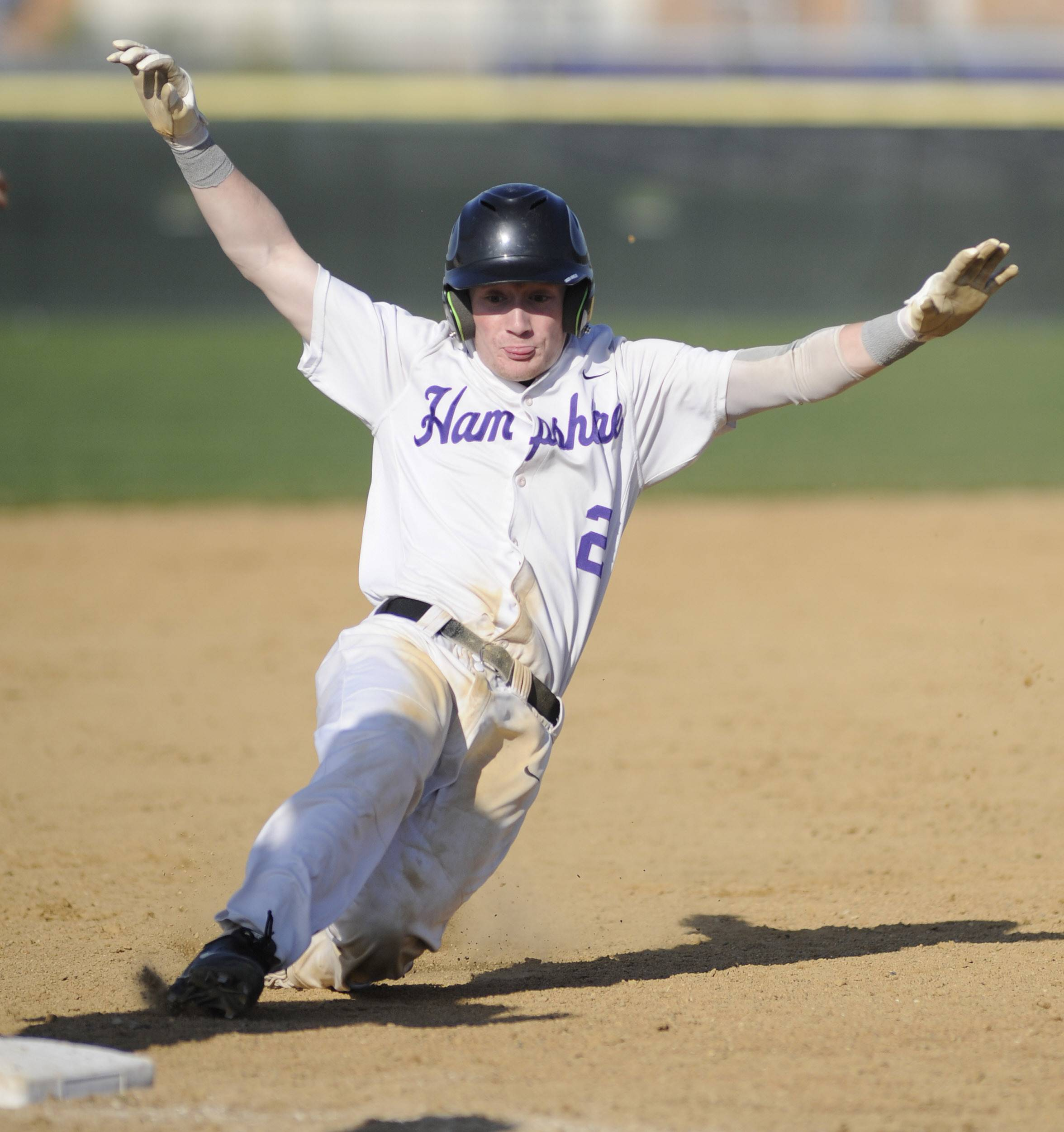Hampshire's RJ Consigny slides safely into third base in the second inning vs. Grayslake Central Friday.