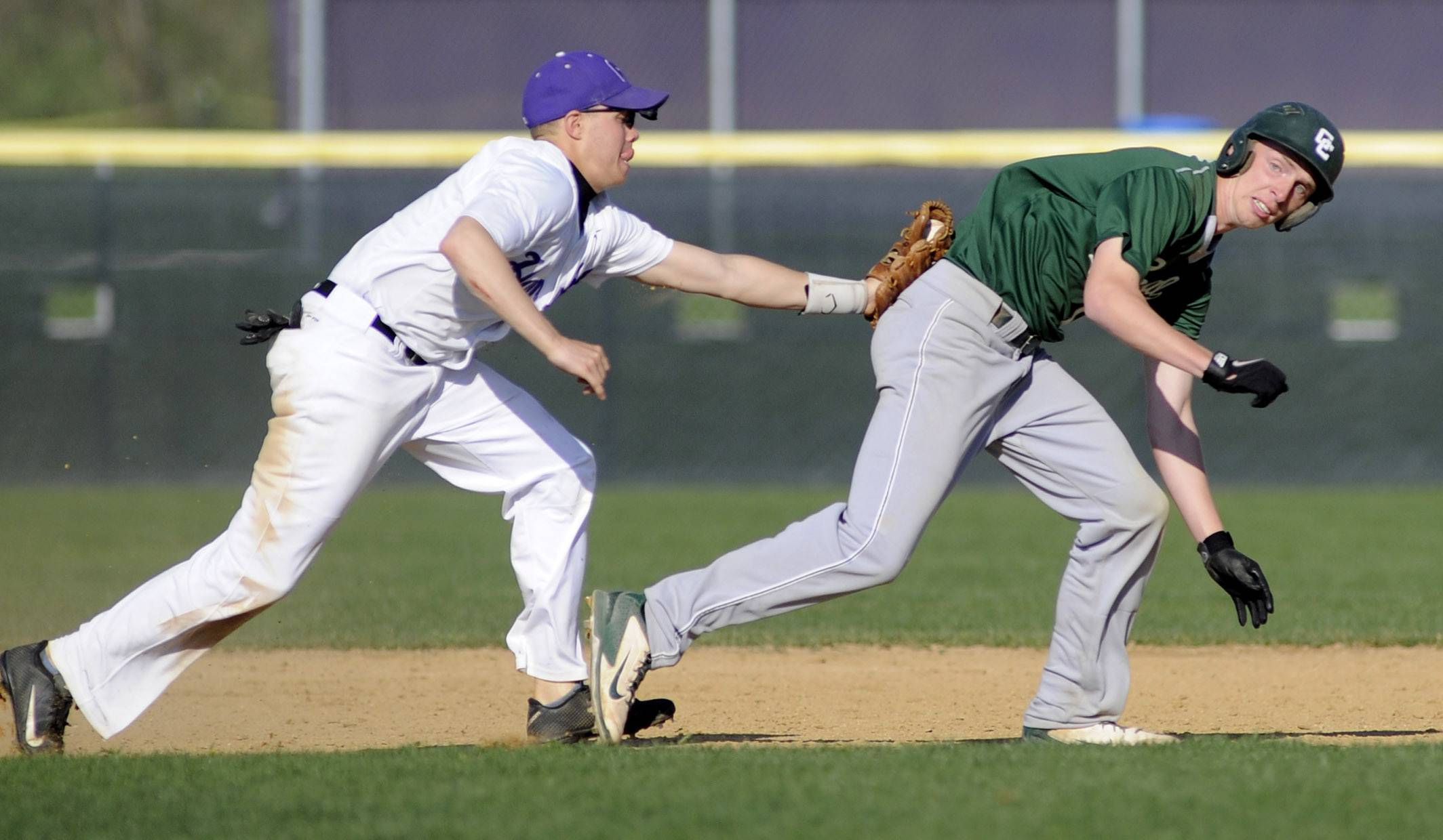 Hampshire's Dillon Kuhn tags out Grayslake Central's Mike Stone as he tries to sprint back to first base in the third inning at Hampshire on Friday.