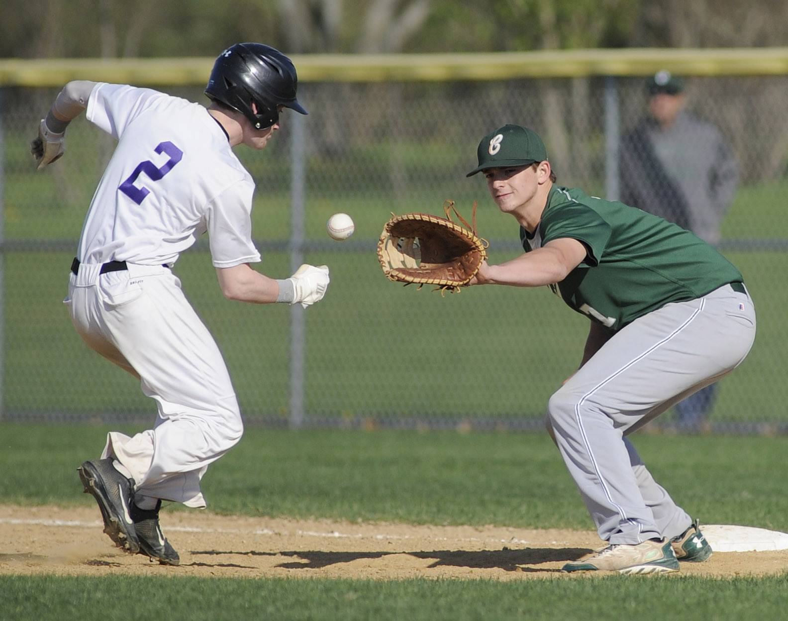 Hampshire's RJ Consigny beats the ball and ends up safe back on first base as Grayslake Central's Kyle Clark takes the throw in the second inning at Hampshire on Friday.