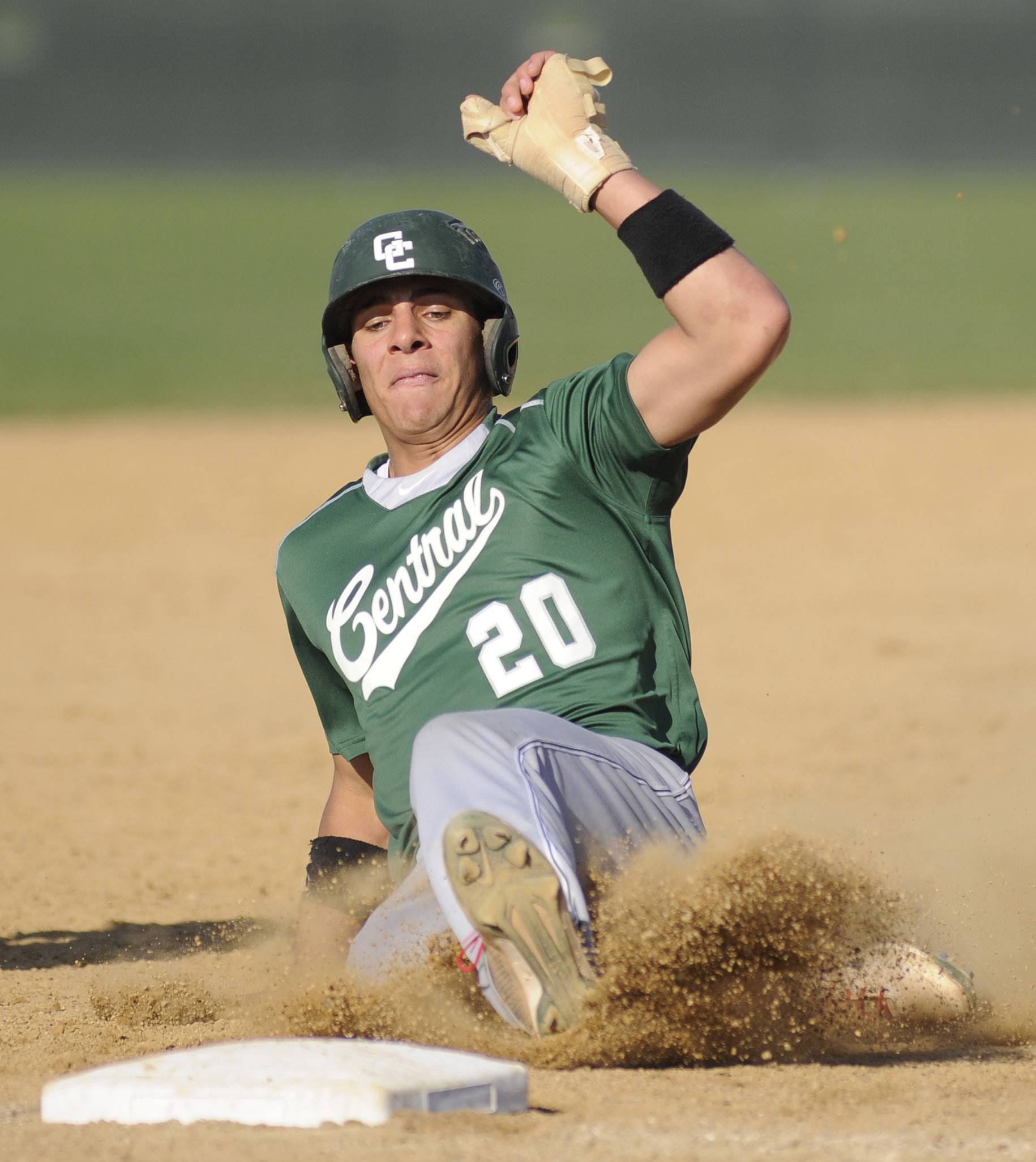 Grayslake Central's Freddie Landers slides safely into third base in the third inning vs. Hampshire Friday.