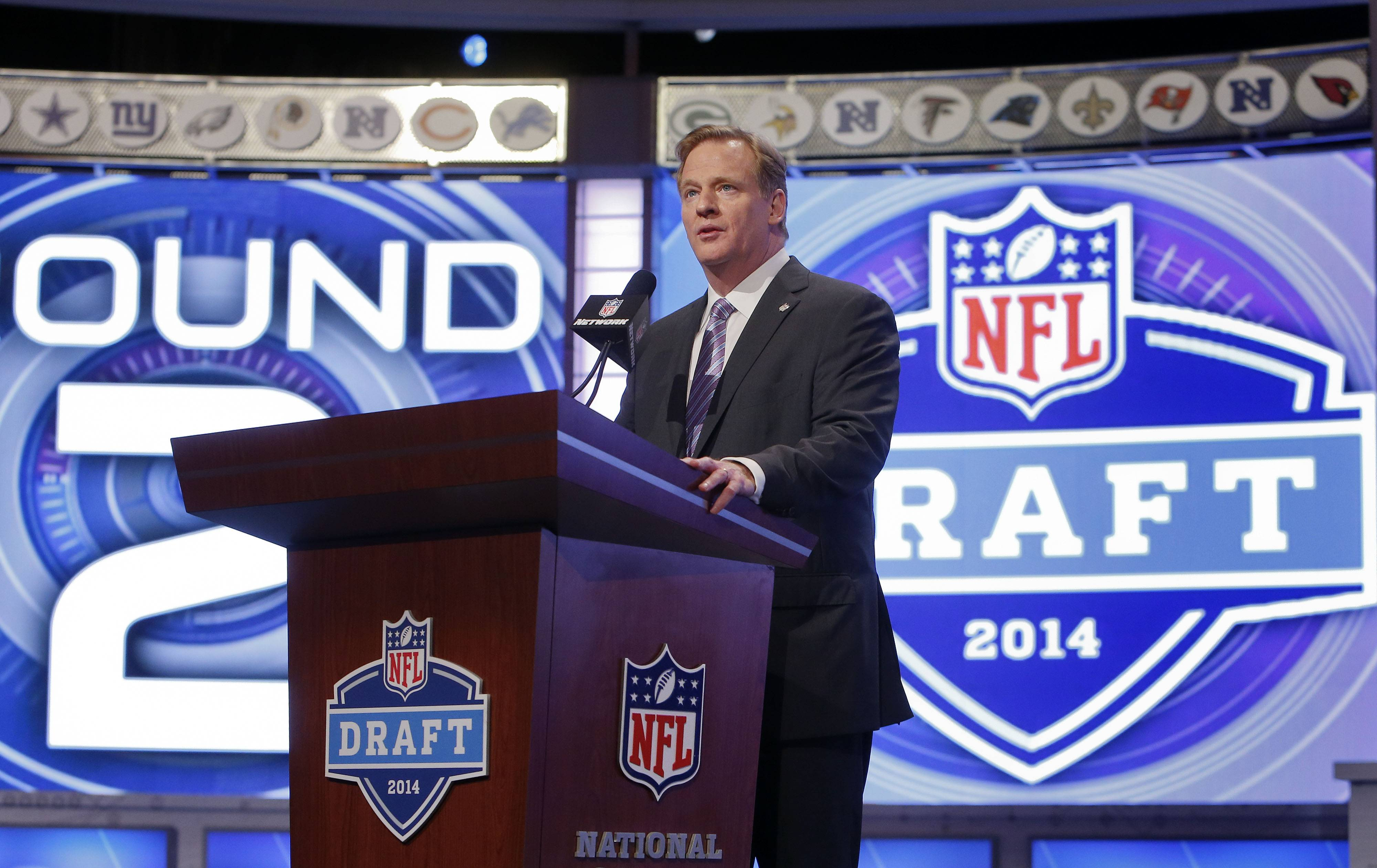 NFL commissioner Roger Goodell announces the opening of the second round of the 2014 NFL Draft, Friday, May 9, 2014, in New York.