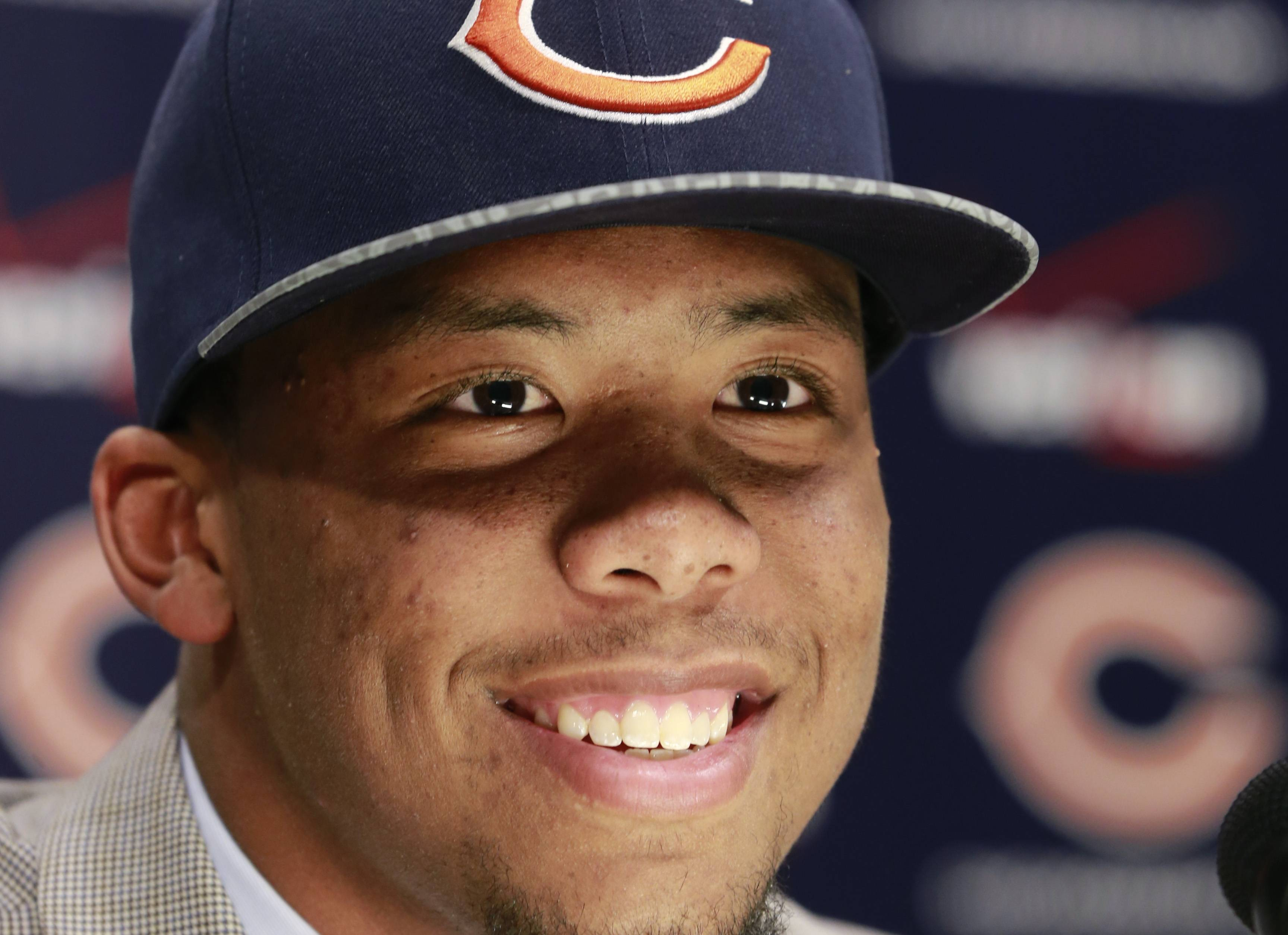 Chicago Bears first round draft pick Kyle Fuller, a cornerback from Virginia Tech, smiles as he responds to a question after being introduced at an NFL football news conference Friday, May 9, 2014, in Lake Forest, Ill.