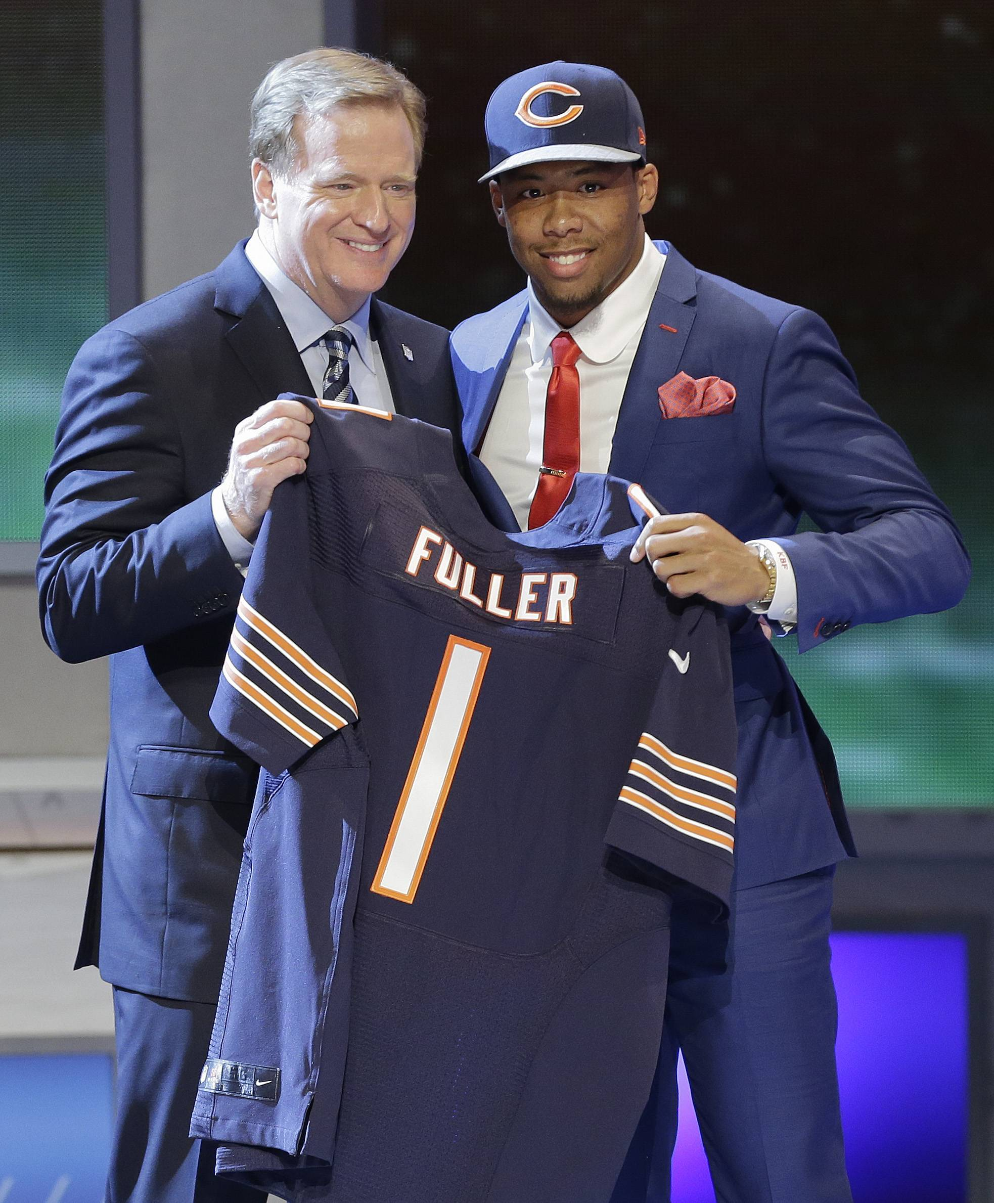 Virginia Tech cornerback Kyle Fuller poses with NFL Commissioner Roger Goodell after being selected by the Chicago Bears as the 14th pick in the first round of the 2014 NFL Draft, Thursday, May 8, 2014, in New York.