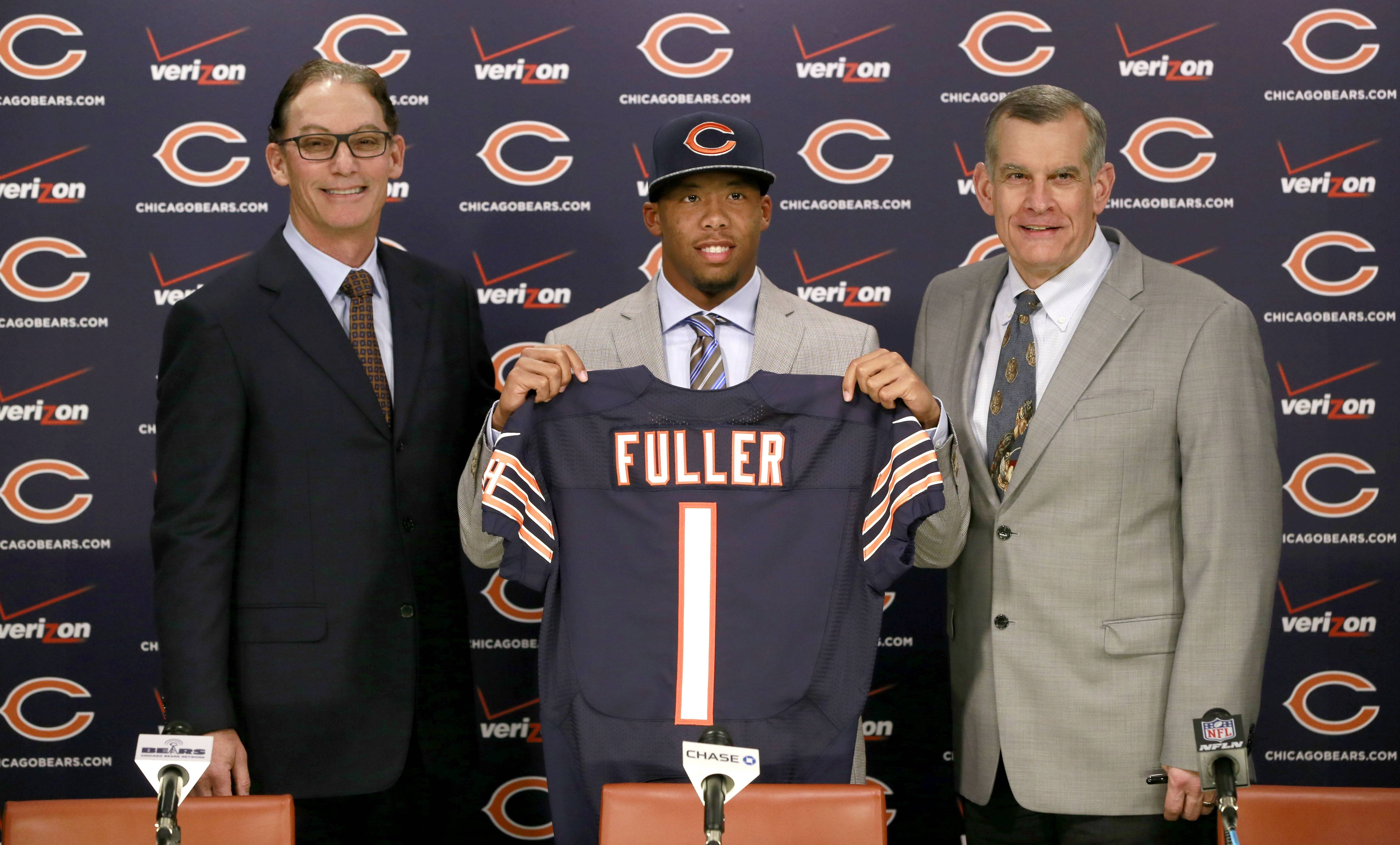 Chicago Bears head coach Marc Trestman, left, and general manager Phil Emery, right, introduce the team's first-round draft pick, Virginia Tech cornerback Kyle Fuller, during an NFL football news conference Friday, May 9, 2014, in Lake Forest, Ill.
