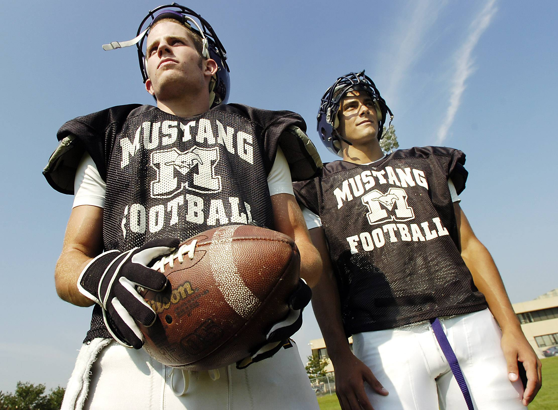Wide receiver #84 Mick Viken (left) and Jimmy Garoppolo at a Rolling Meadows practice.