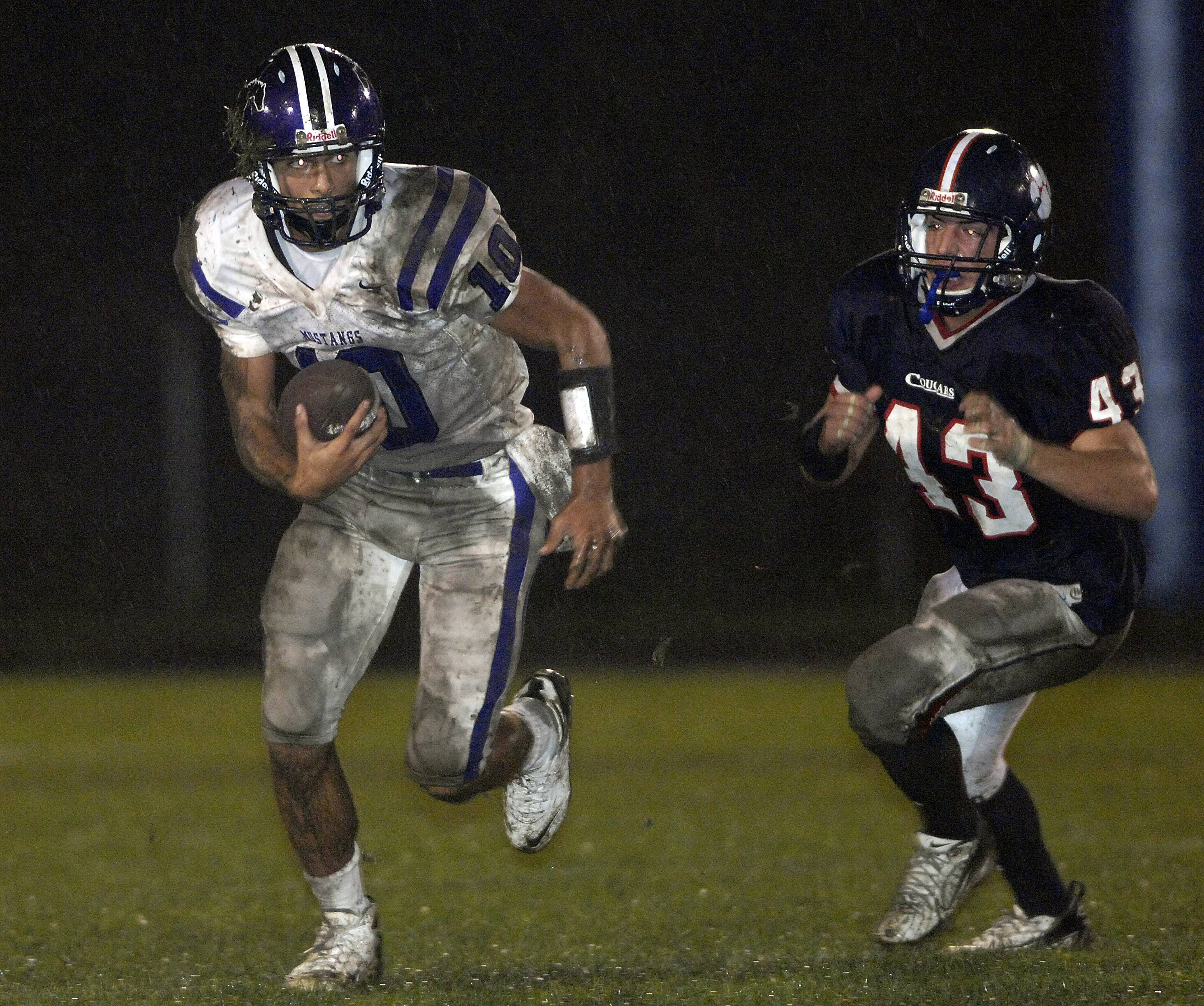Rolling Meadows QB Jimmy Garoppolo runs from Conant's Jake Prestia.