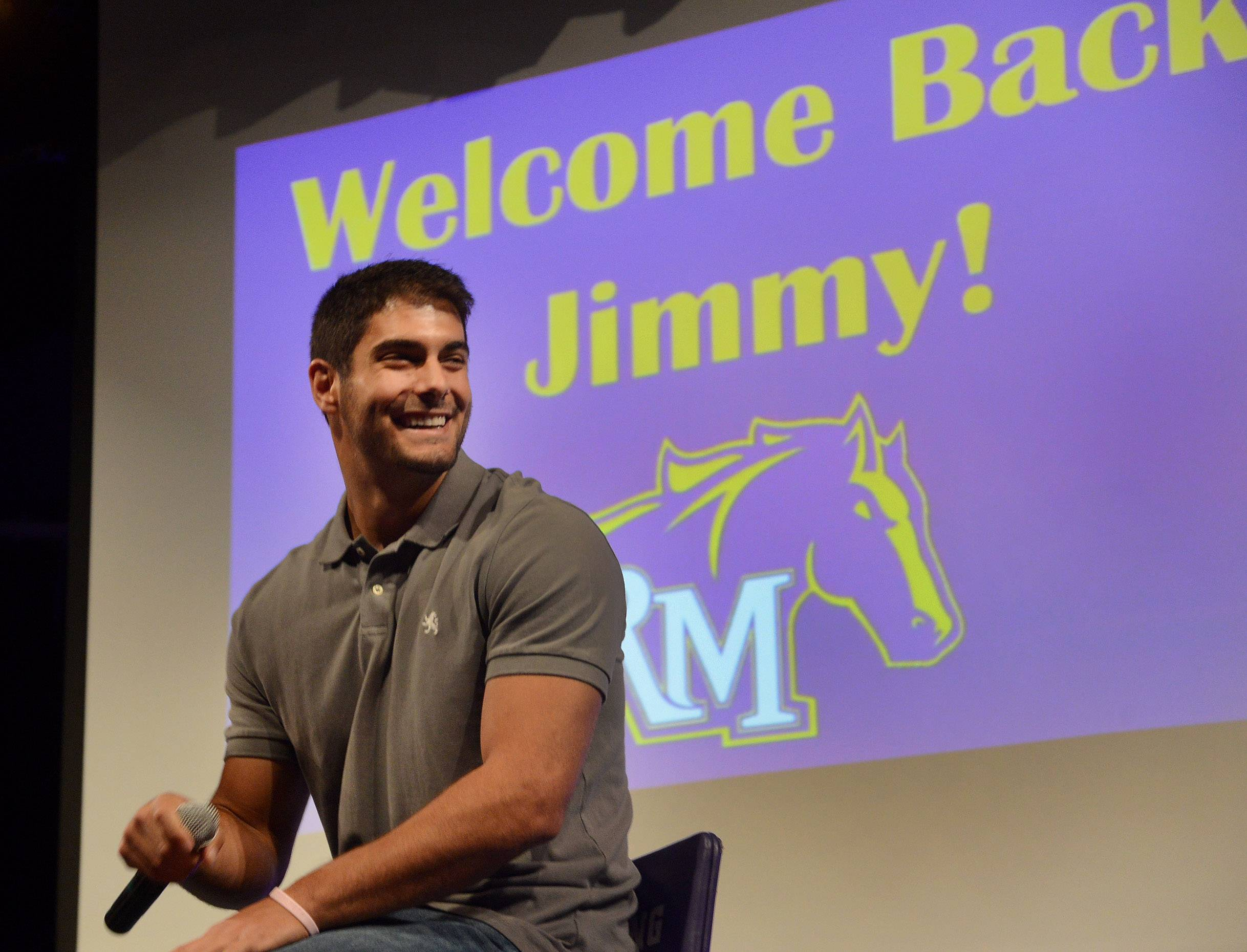 NFL quarterback prospect Jimmy Garappolo returns to Rolling Meadows High School to reunite with former coaches and players and to talk to students.