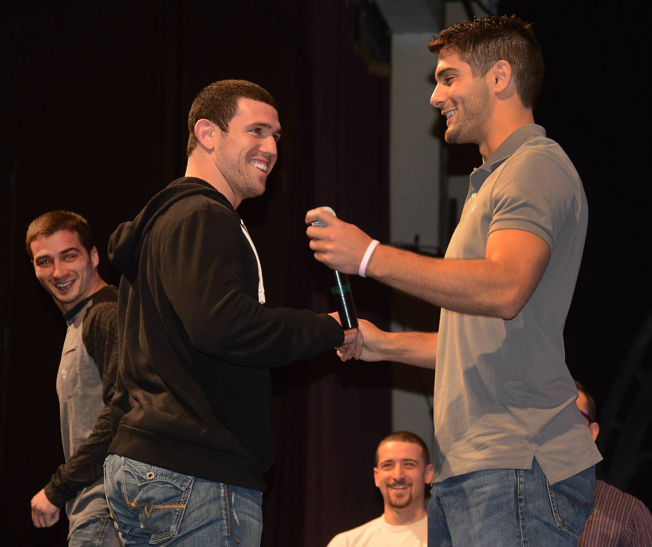 NFL quarterback prospect Jimmy Garappolo shakes hands with former teammate Tony Taibi.