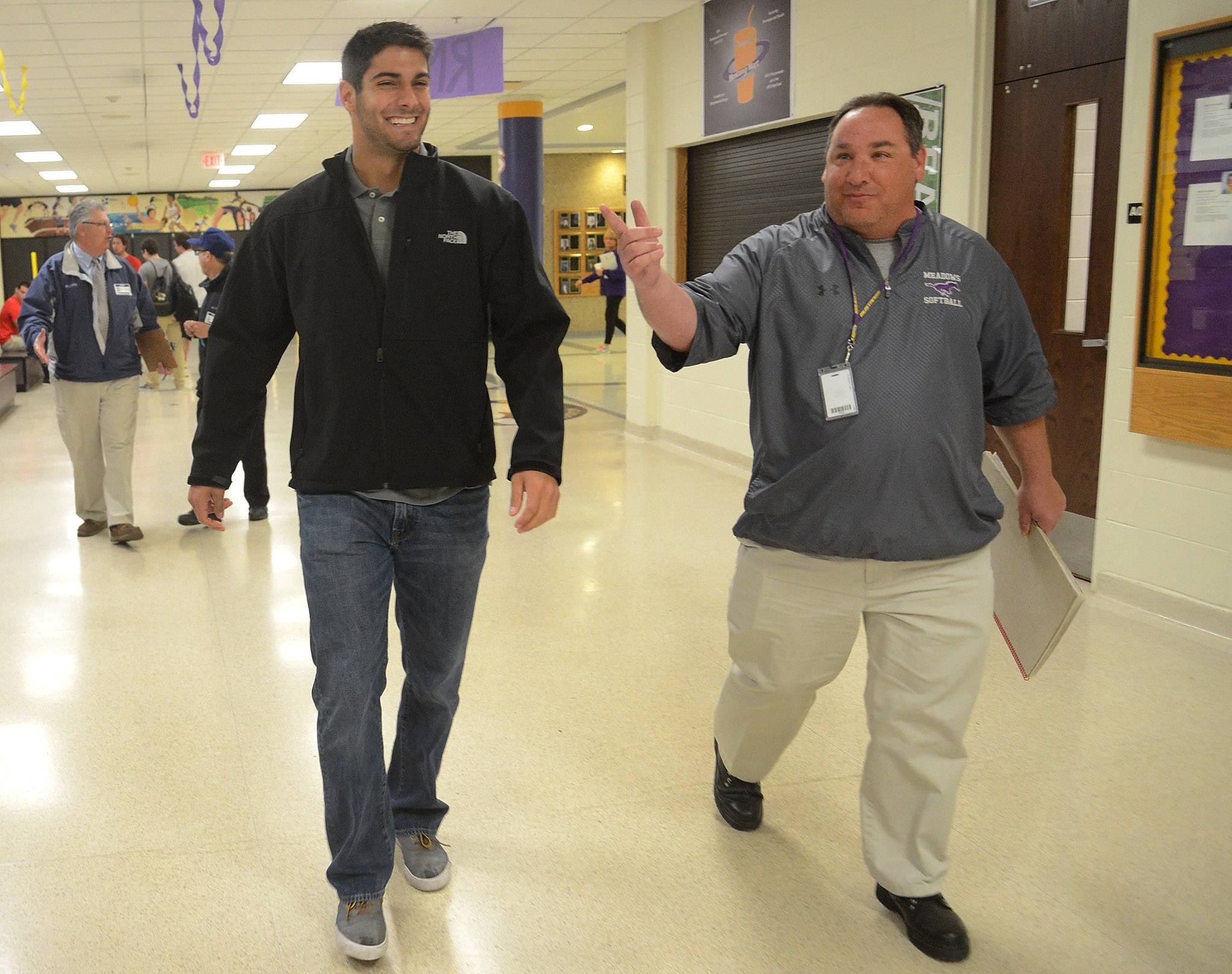 NFL quarterback prospect Jimmy Garappolo walks with former coach Tony Wolanski to the Rolling Meadows High School auditorium.