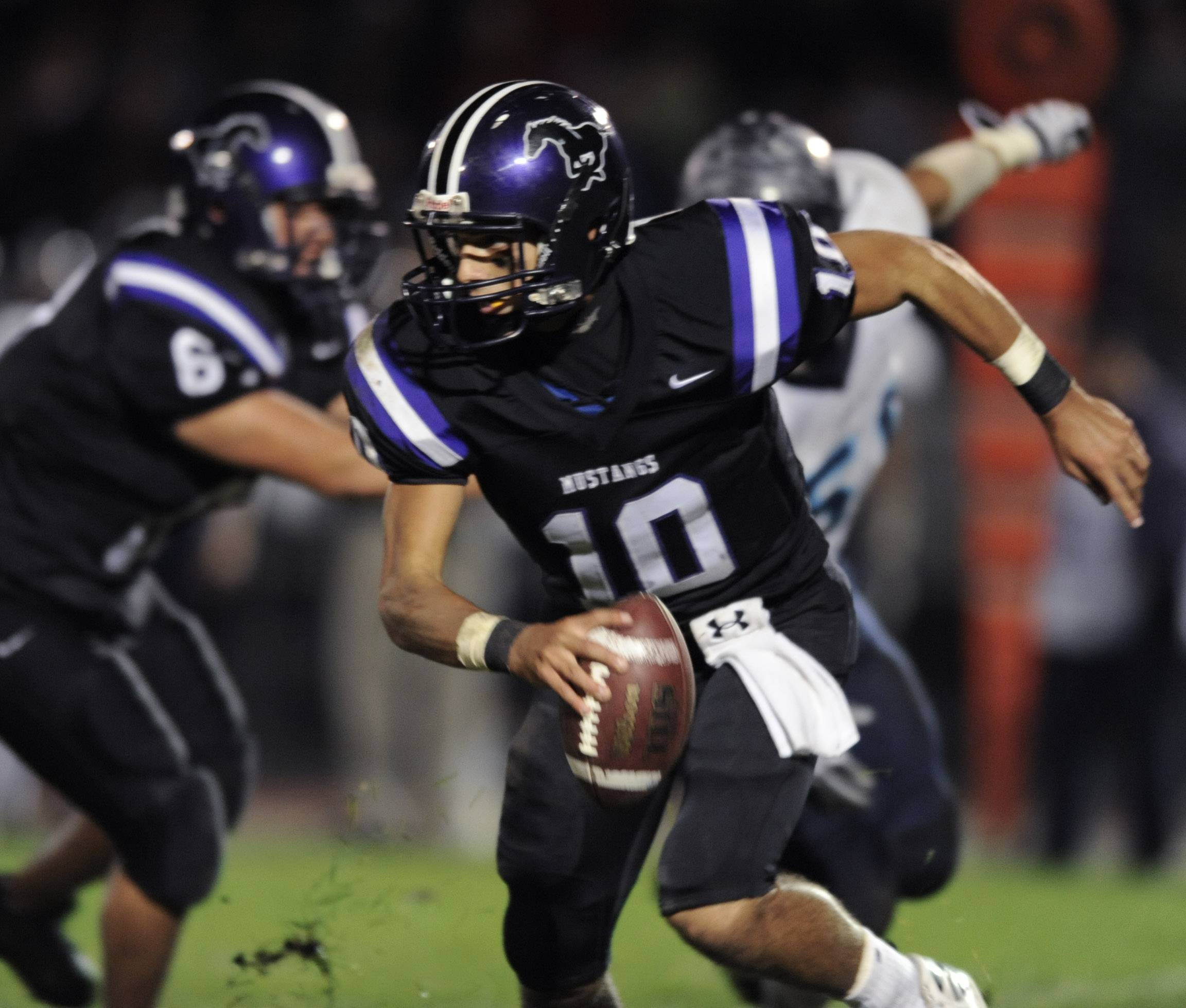 Rolling Meadows quarterback Jimmy Garoppolo scrambles against Prospect.