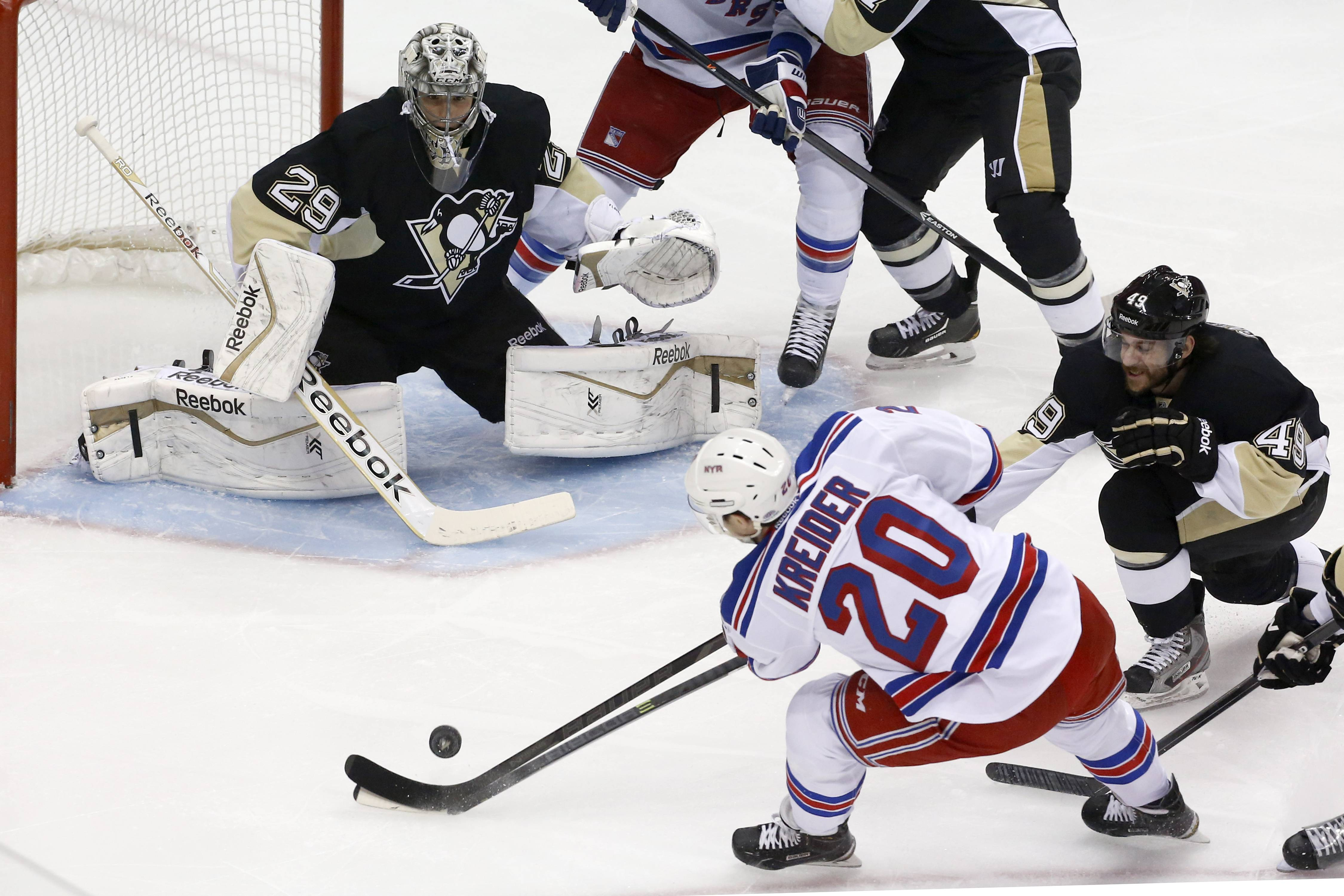 New York Rangers' Chris Kreider (20) cannot get a shot past Pittsburgh Penguins goalie Marc-Andre Fleury (29) and Brian Gibbons (49) in the first period of Game 5 of a second-round NHL playoff hockey series in Pittsburgh, Friday, May 9, 2014.