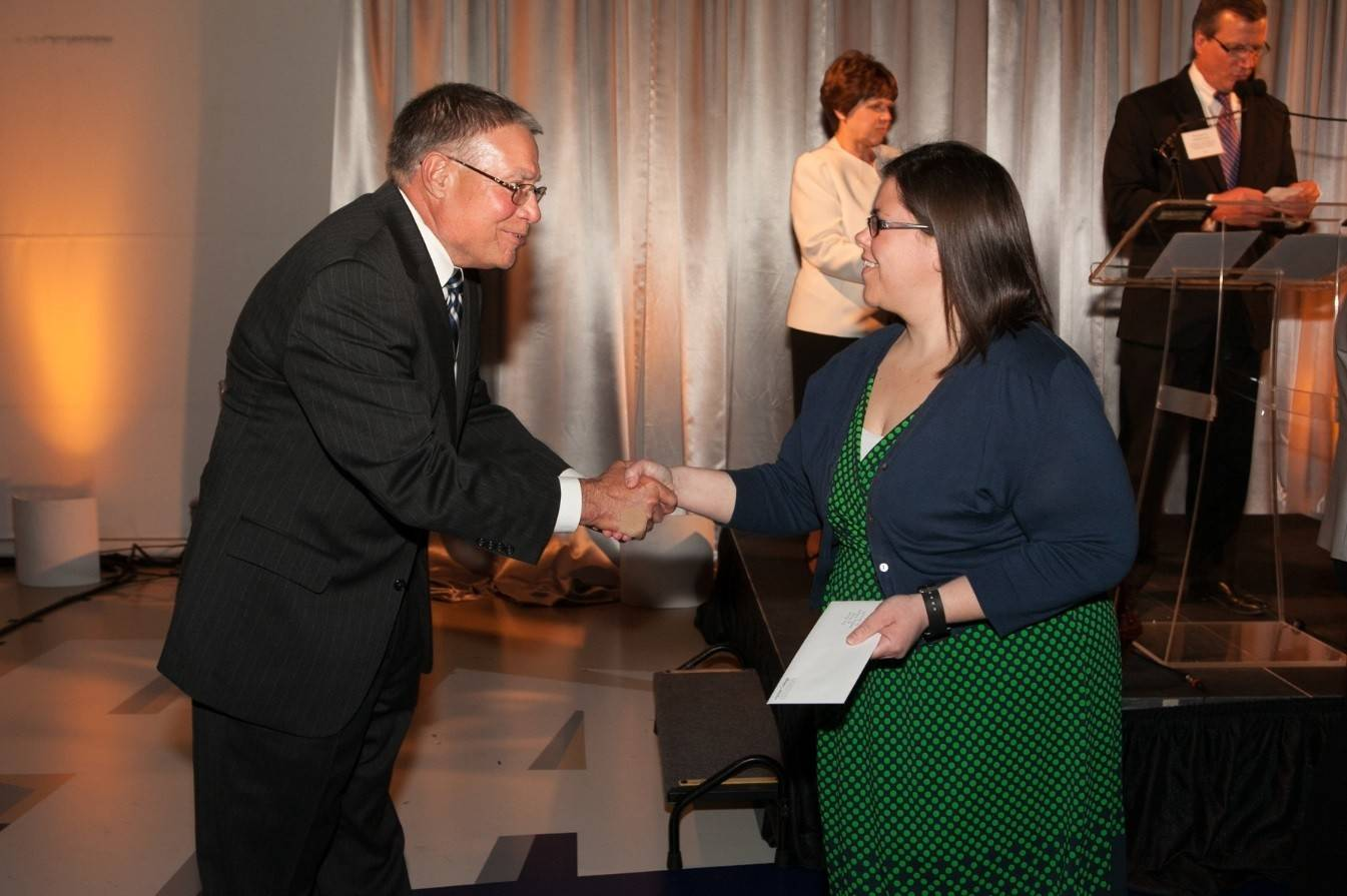 Harper College President Dr. Ken Ender congratulates student Liz Franke, a recipient of two scholarships through the Harper College Educational Foundation.