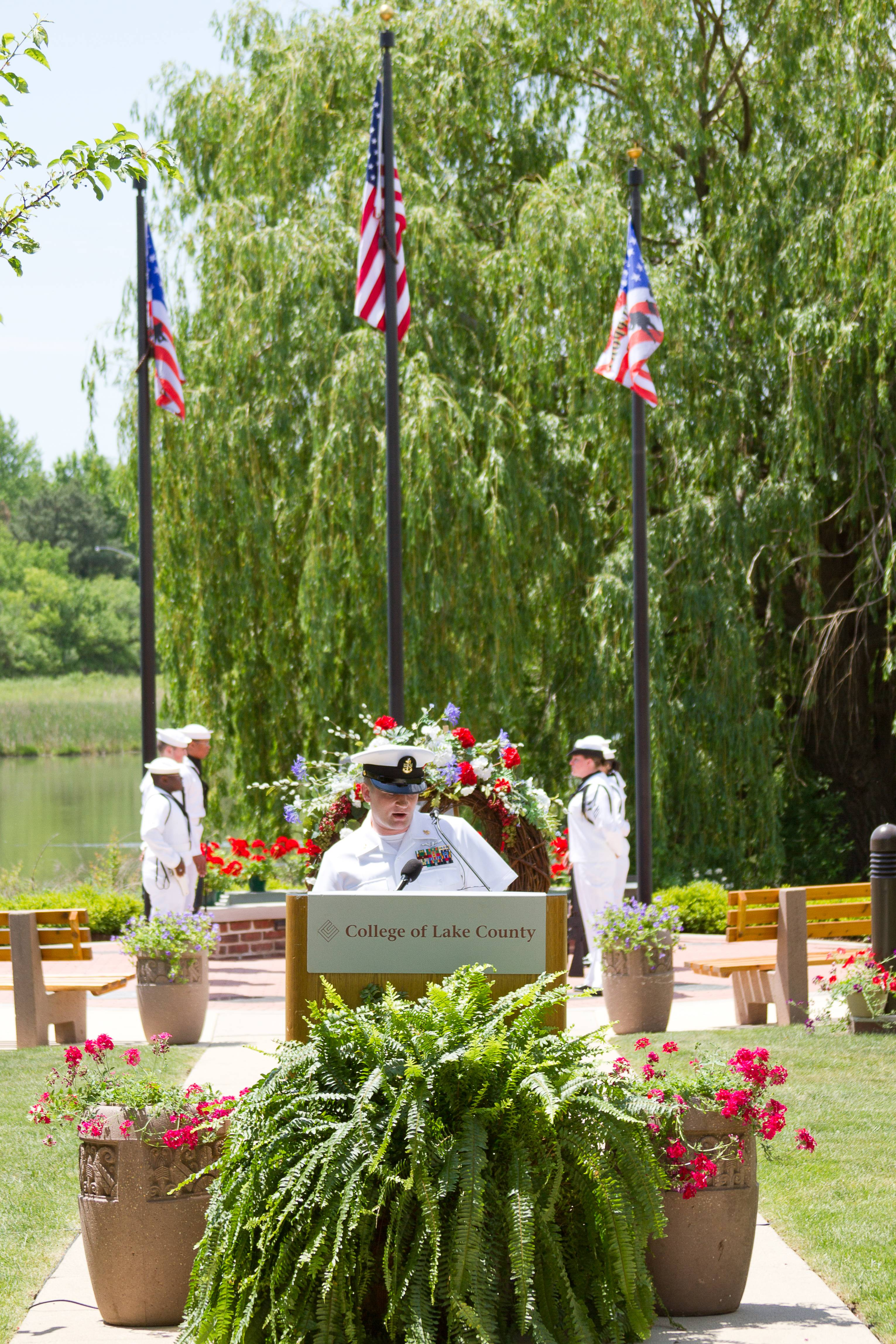 U.S. Navy personnel assist at a CLC Memorial Day ceremony. The seventh annual event will be held May 23 at noon.College of Lake County