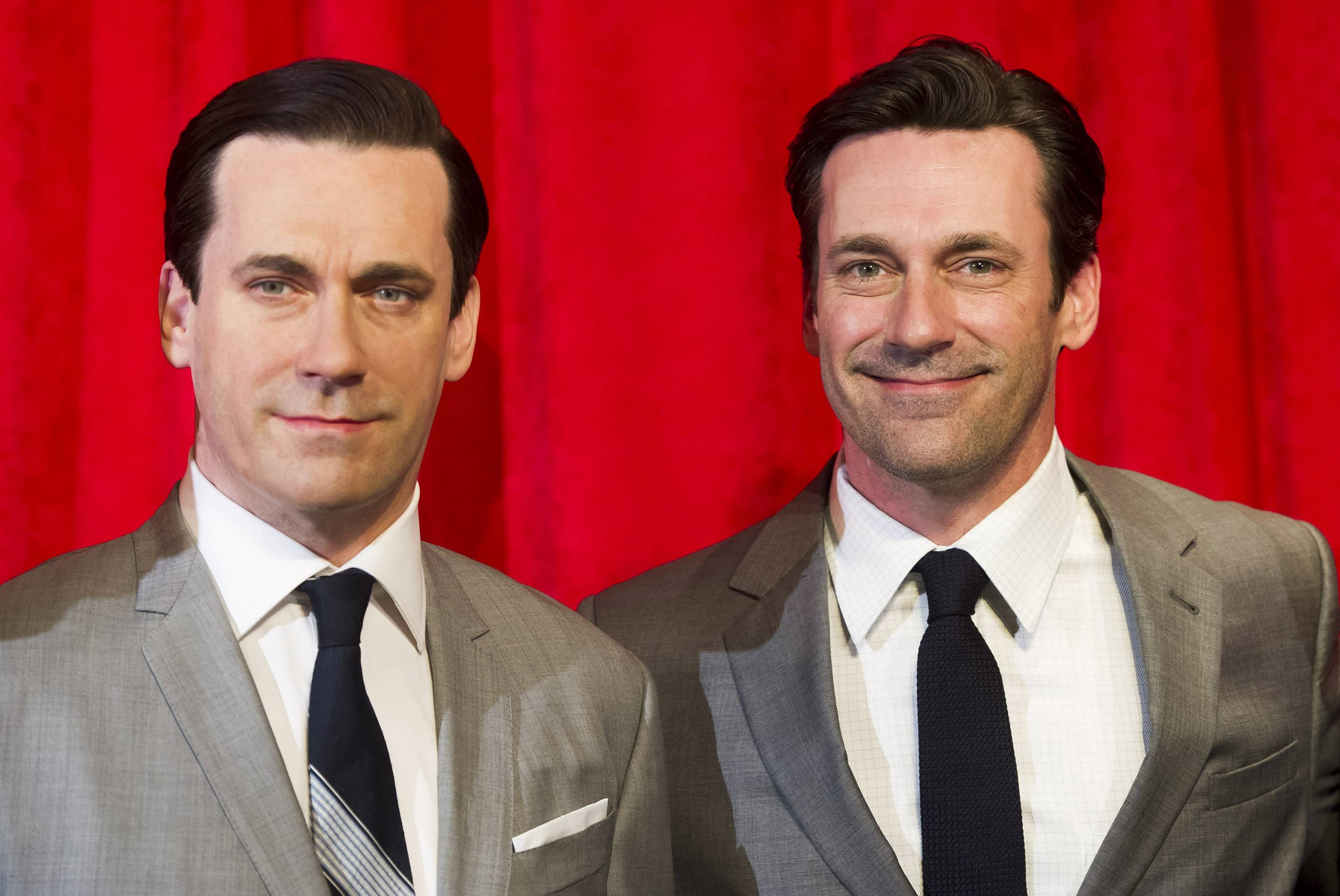 Jon Hamm, right, poses with his wax likeness at an unveiling at Madame Tussauds on Friday, May 9, 2014 in New York.